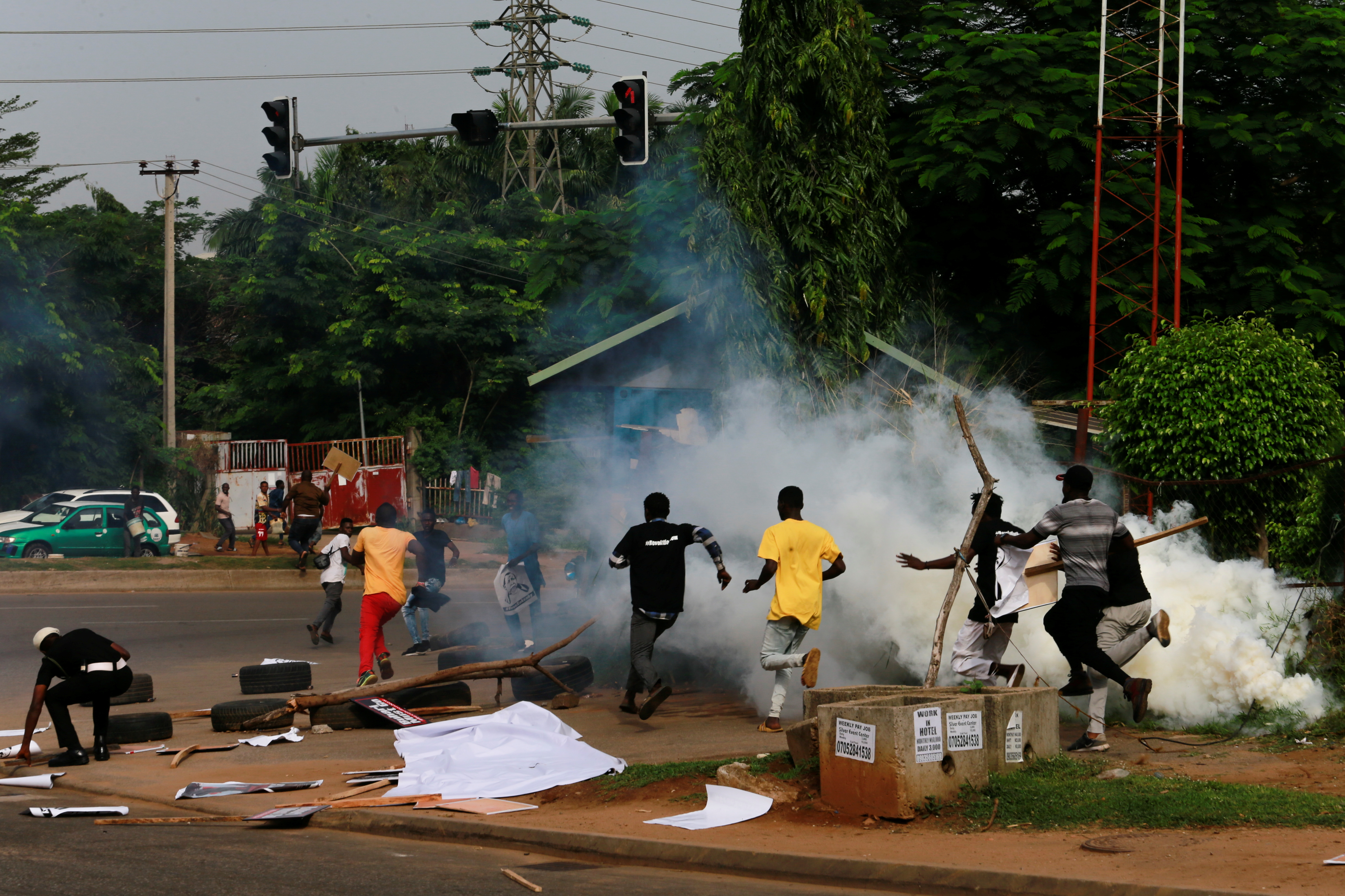Protesters run after police fired tear gas during a June 12 Democracy Day rally in Abuja, Nigeria June 12, 2021. REUTERS/Afolabi Sotunde