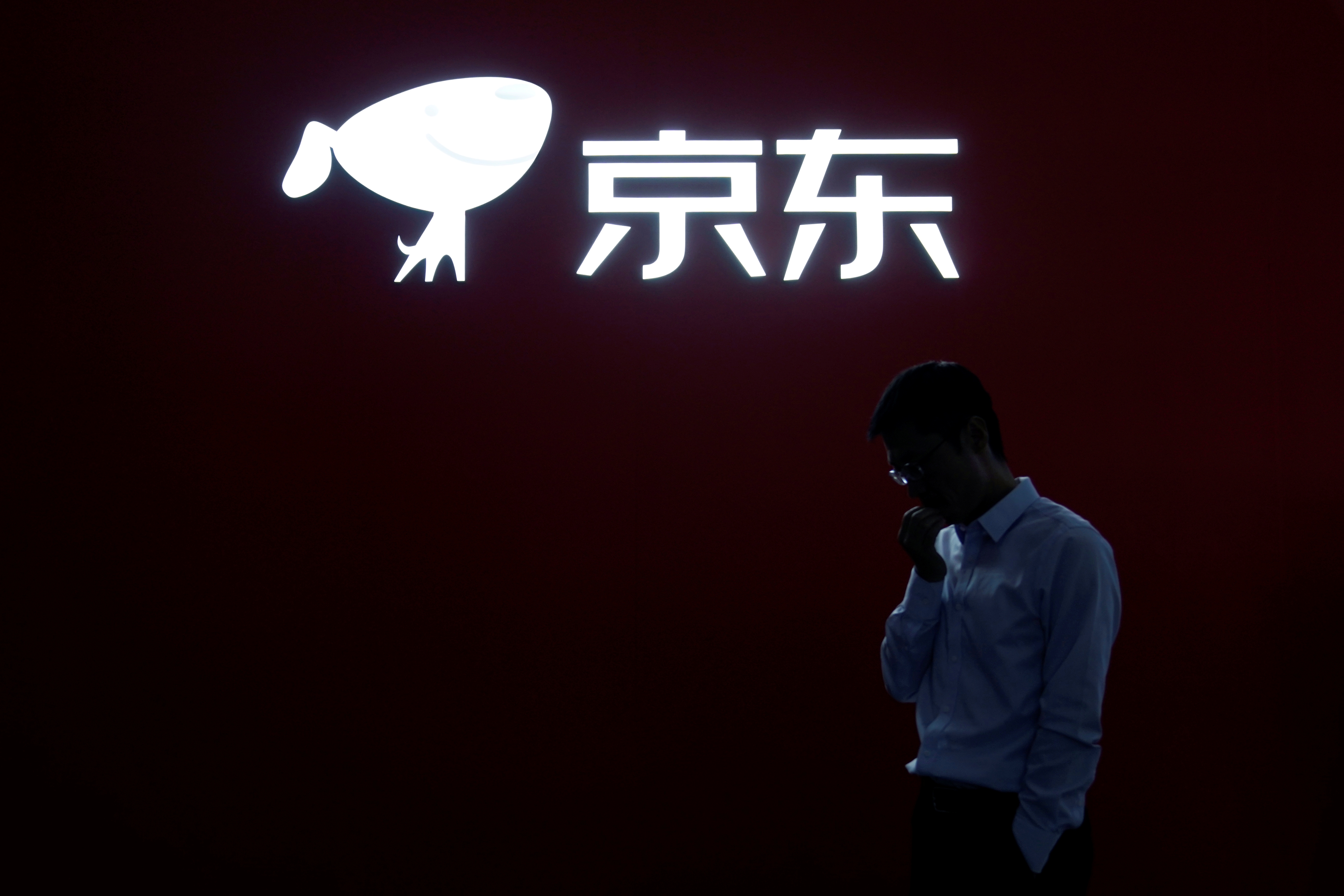 A JD.com sign is seen at the World Internet Conference (WIC) in Wuzhen, Zhejiang province, China, October 20, 2019. REUTERS/Aly Song