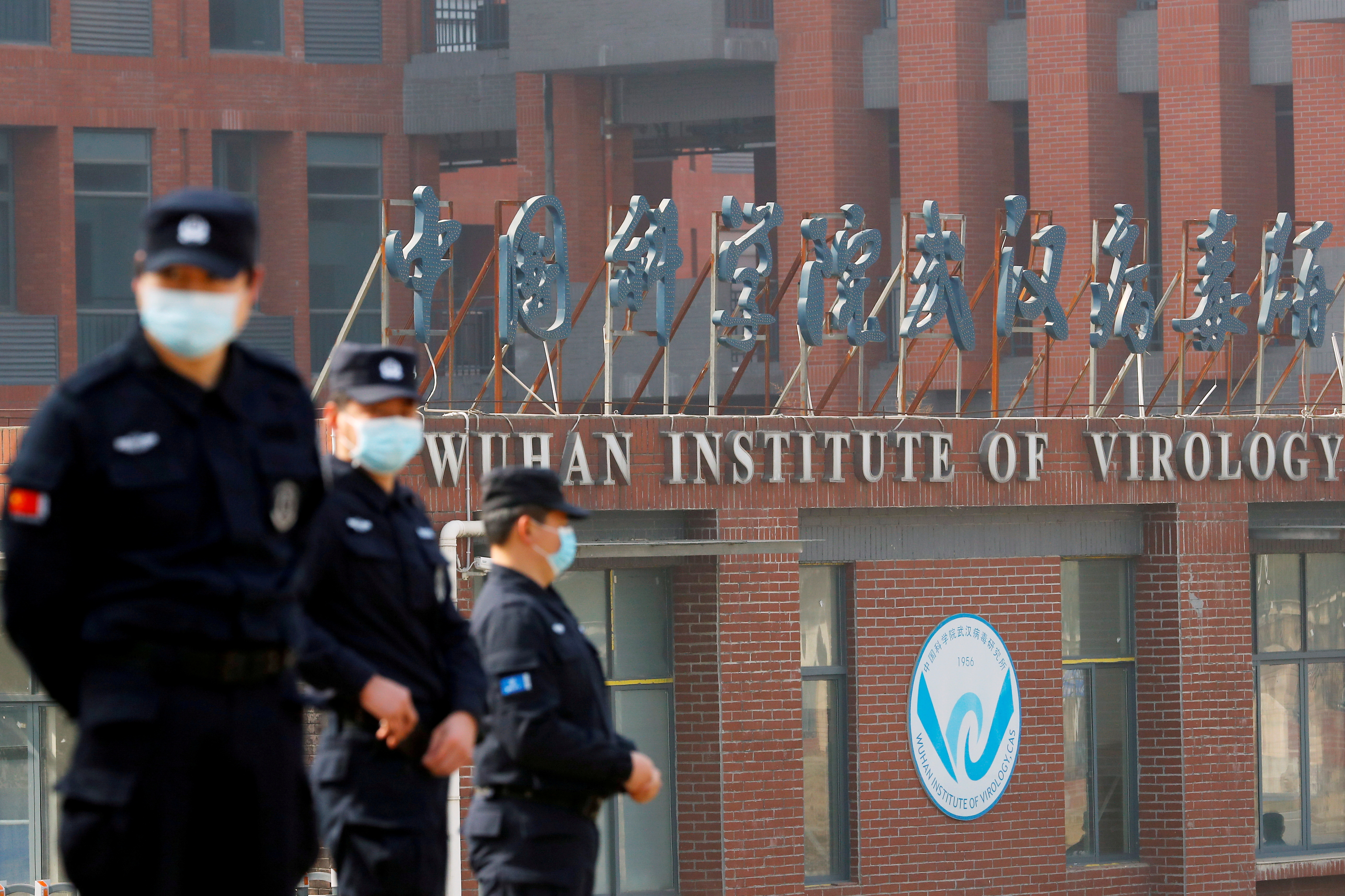 Security personnel keep watch outside the Wuhan Institute of Virology during the visit by the World Health Organization (WHO) team tasked with investigating the origins of the coronavirus disease (COVID-19), inWuhan, Hubei province, China February 3, 2021. REUTERS/Thomas Peter