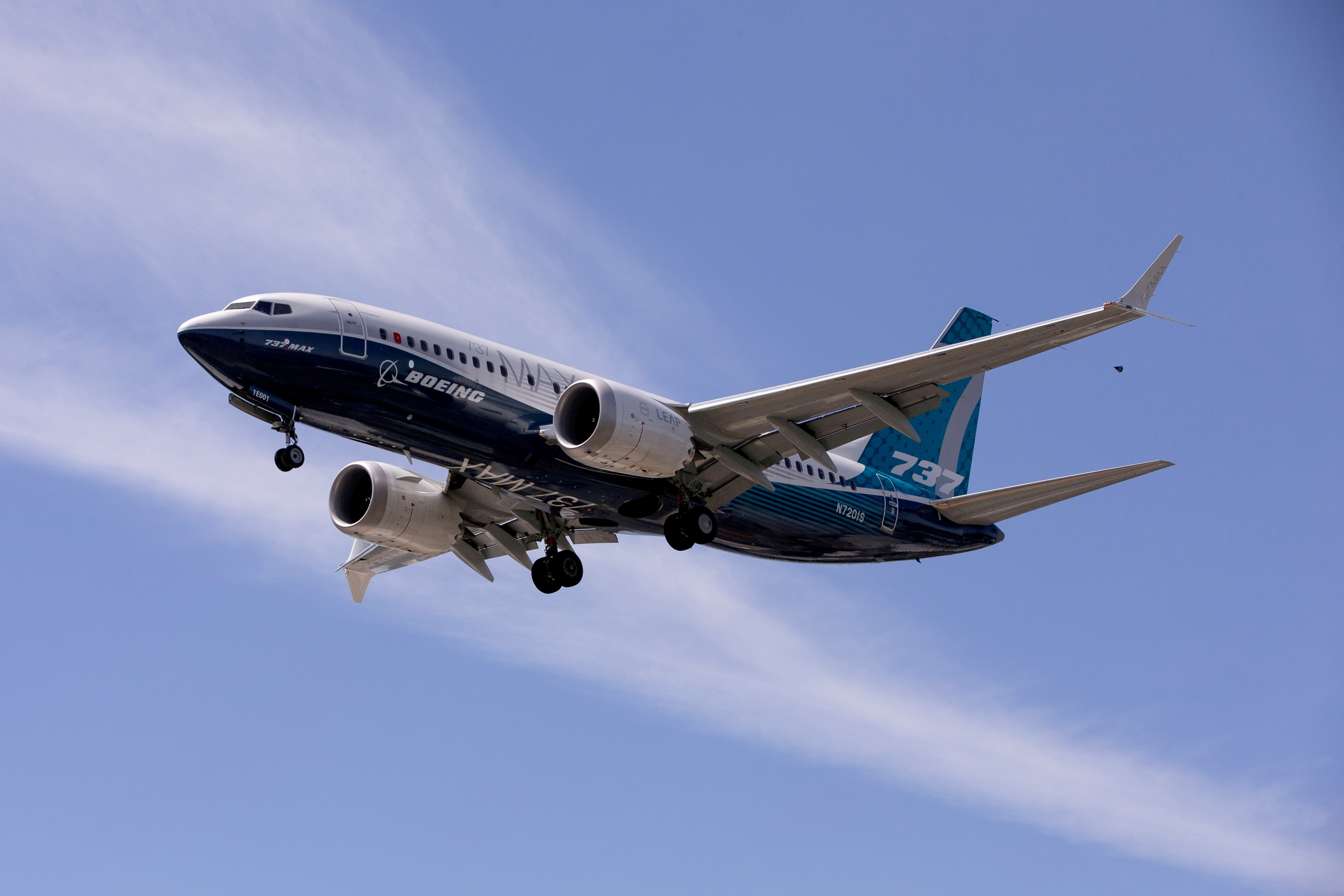 A Boeing 737 MAX airplane lands after a test flight at Boeing Field in Seattle, Washington, U.S. June 29, 2020. REUTERS/Karen Ducey/File Photo