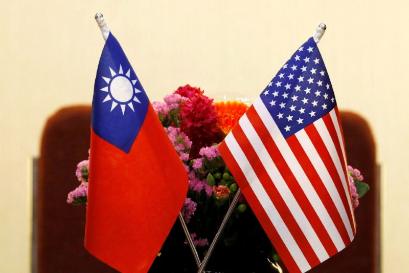 Flags of Taiwan and U.S. are placed for a meeting in Taipei, Taiwan March 27, 2018. REUTERS/Tyrone Siu/File Photo