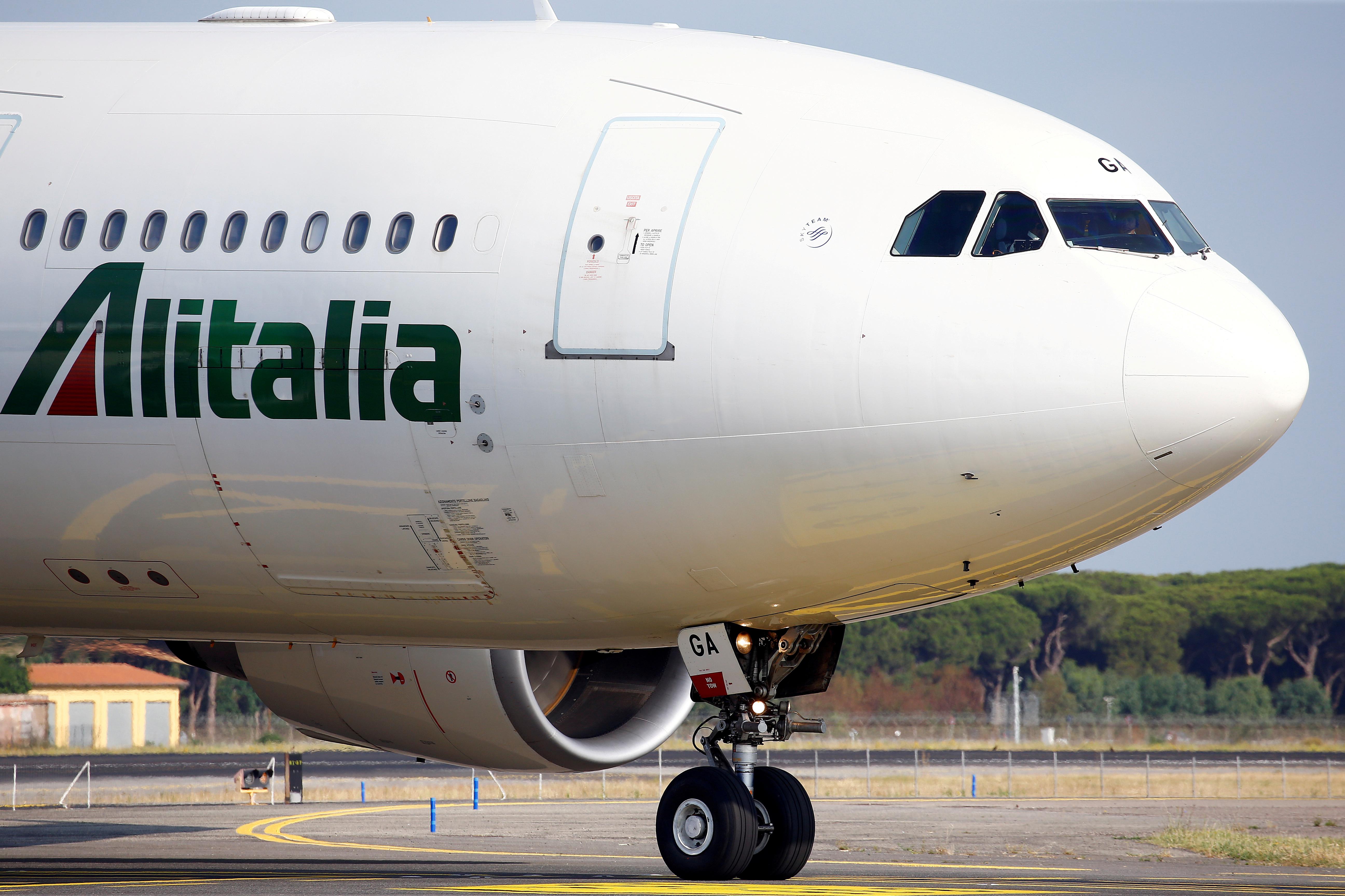 An Alitalia plane is seen before take-off from the Leonardo da Vinci-Fiumicino Airport in Rome, Italy, June 21, 2018. REUTERS/Stefano Rellandini/File Photo