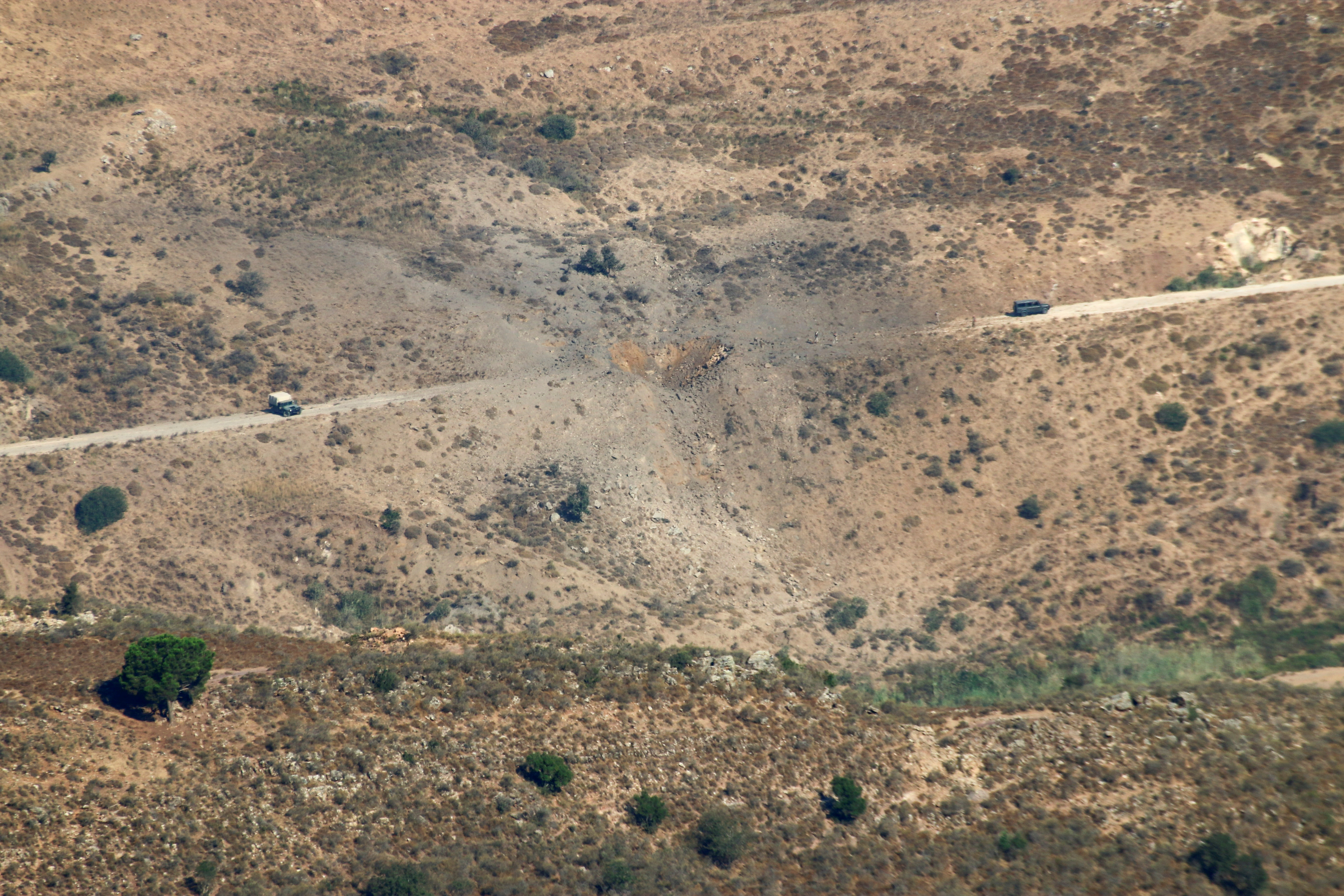 A view shows the damage in the aftermath of Israeli air strikes as seen from Marjayoun, near the border with Israel, Lebanon August 5, 2021. REUTERS/Karamallah Daher