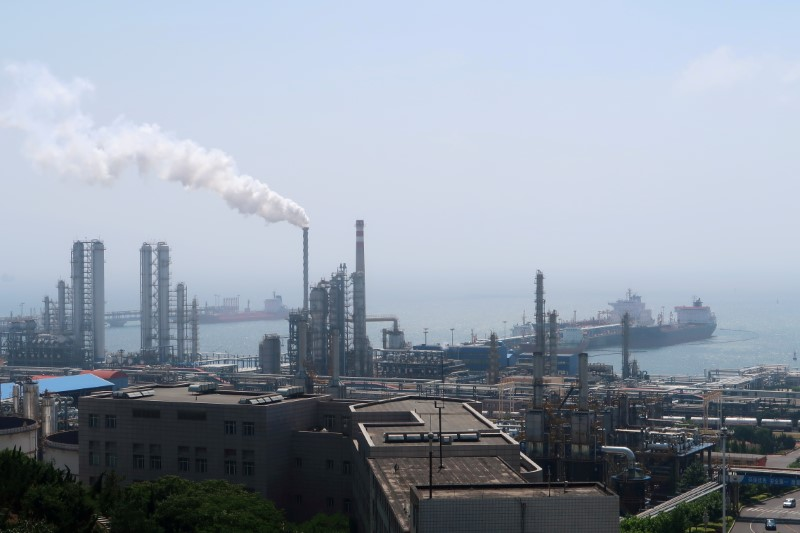 China National Petroleum Corporation (CNPC)'s Dalian Petrochemical Corp refinery is seen near the downtown of Dalian in Liaoning province, China July 17, 2018. Picture taken July 17, 2018. REUTERS/Chen Aizhu//File Photo