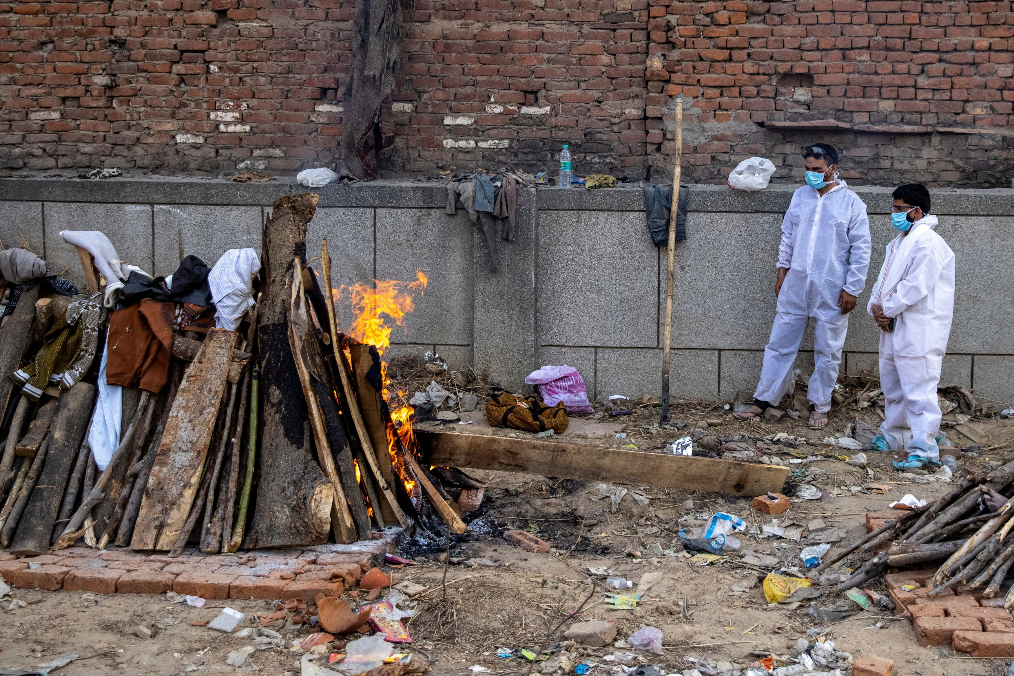 Amid second wave of coronavirus in India and oxygen shortage, mass cremations started as Delhi has been facing a deluge of COVID-19 deaths.