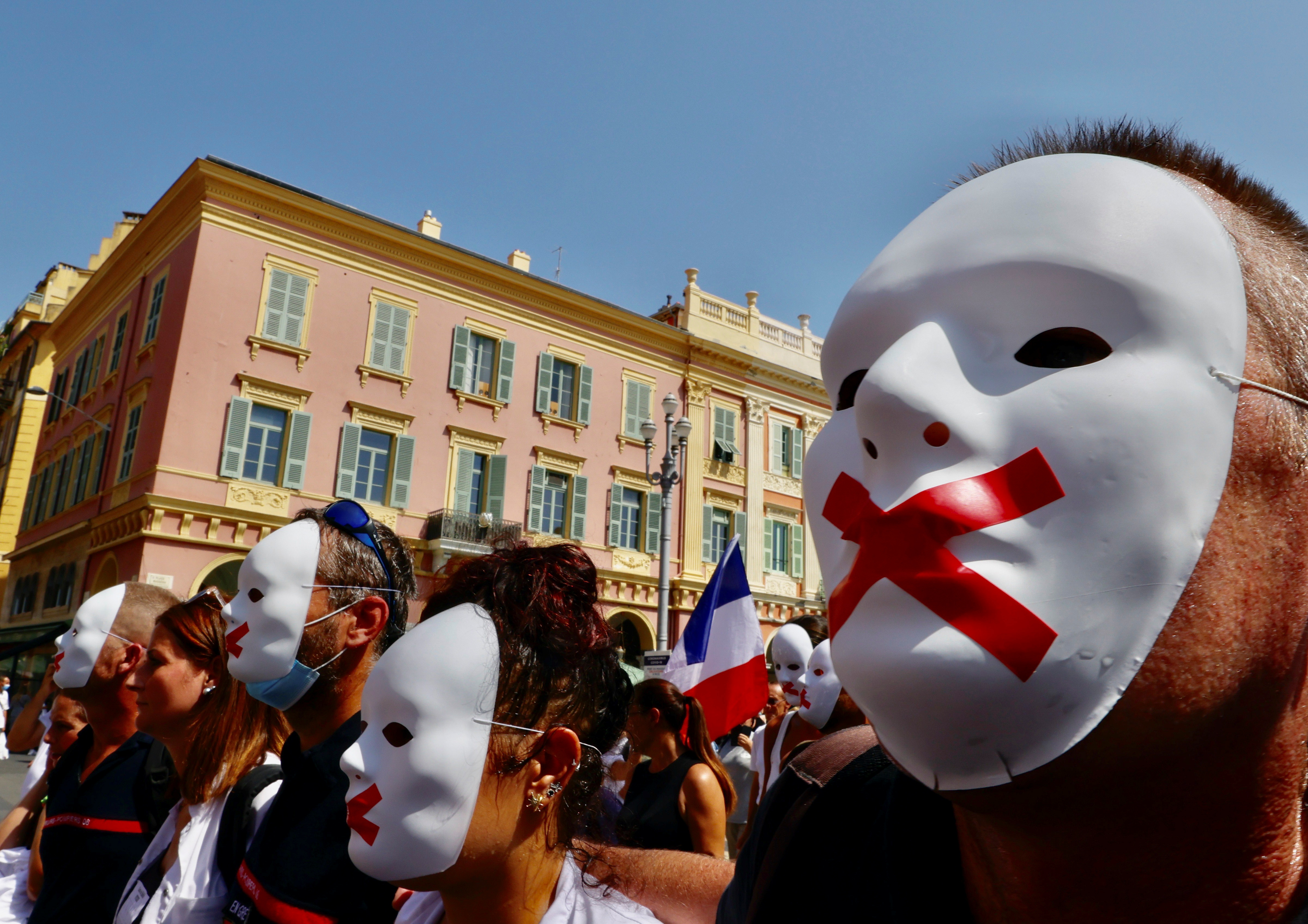 Protesters march against the coronavirus disease (COVID-19) vaccination and the use of health passes to restaurants, bars, trains and planes in Nice, France, August 14, 2021. REUTERS/Eric Gaillard