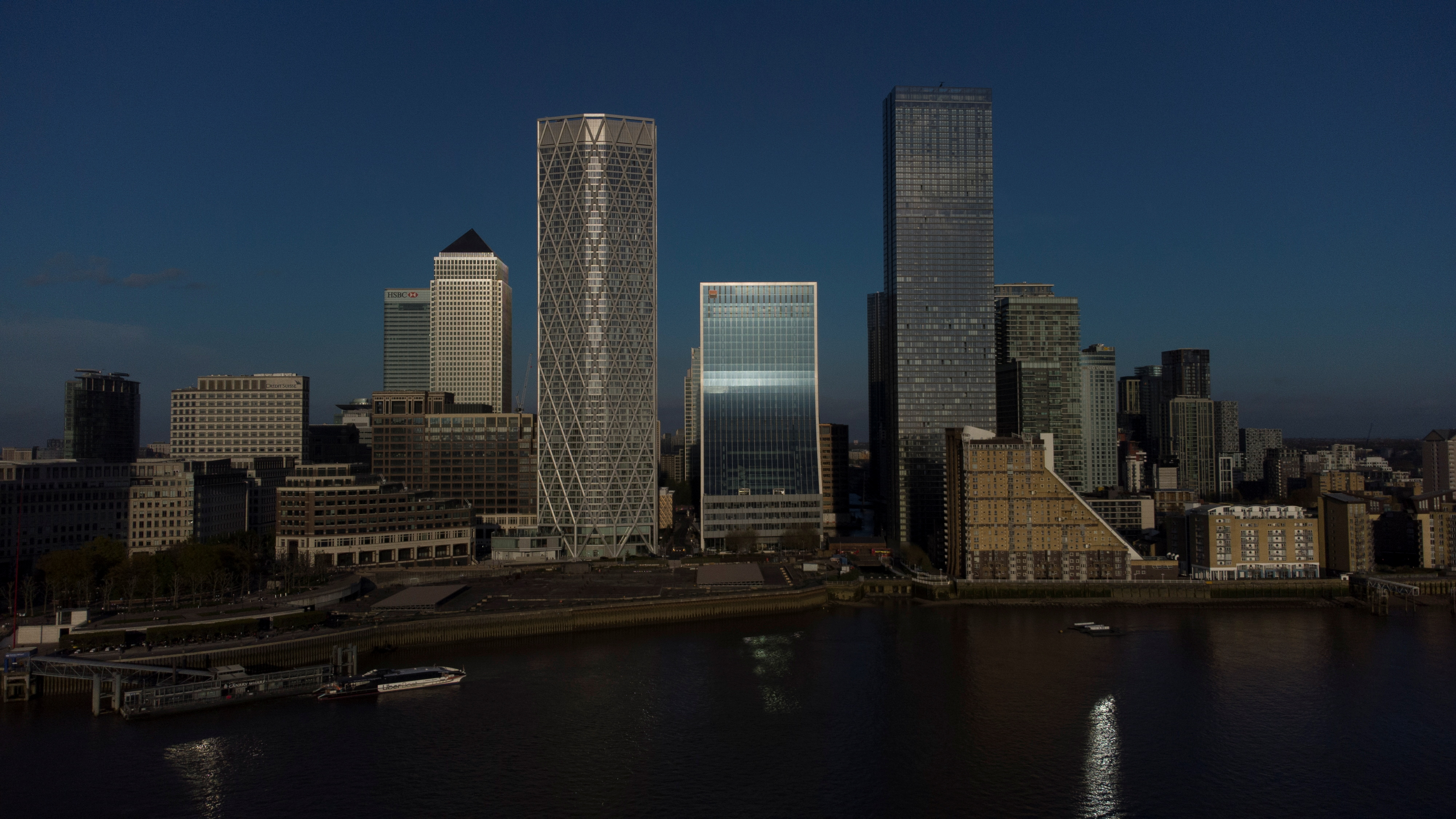 A general view of the Canary Wharf financial district in London, Britain April 25, 2021.  Picture taken April 25 with a drone. REUTERS/Kevin Coombs