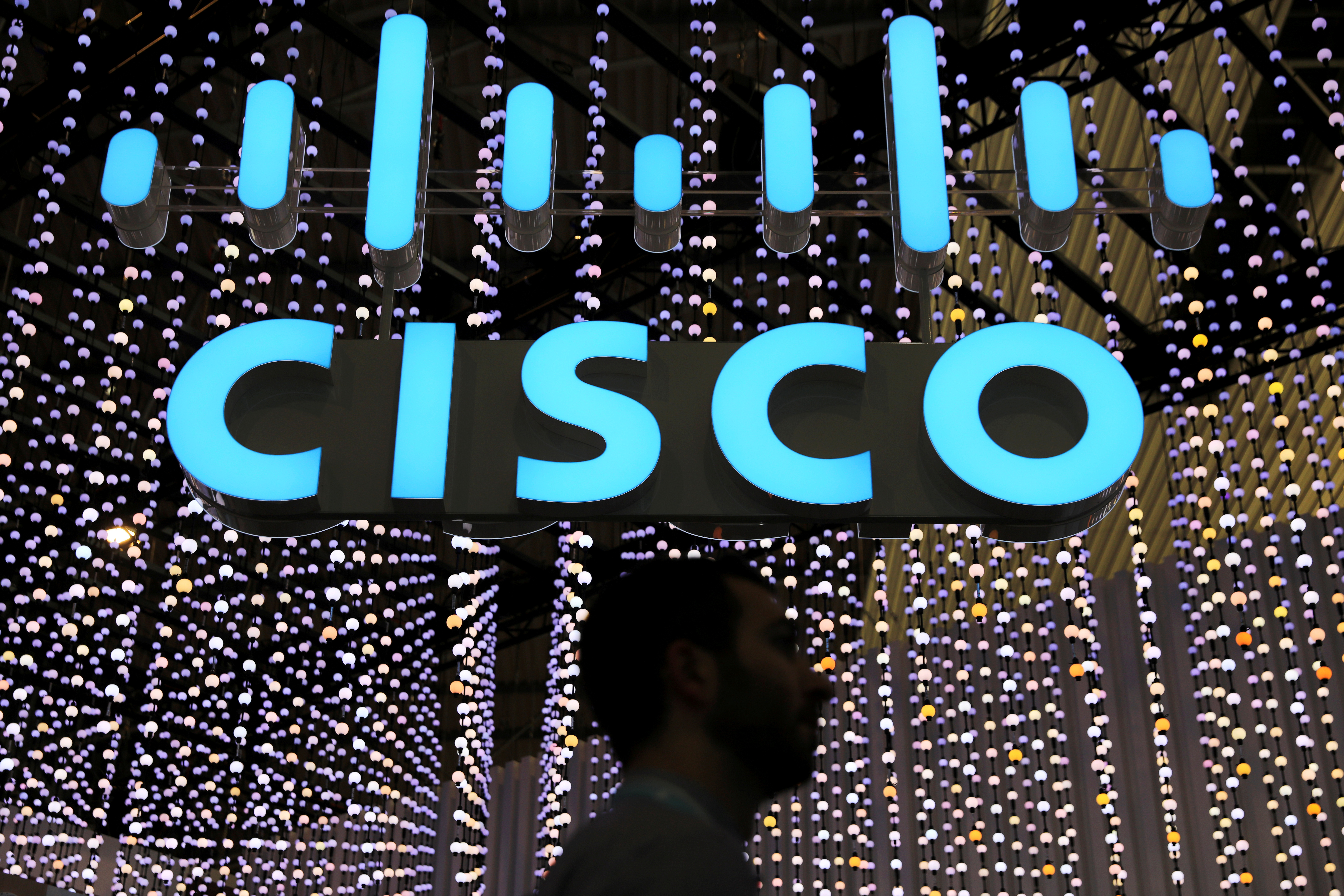 A man passes under a Cisco logo at the Mobile World Congress in Barcelona, Spain February 25, 2019. REUTERS/Sergio Perez/File Photo