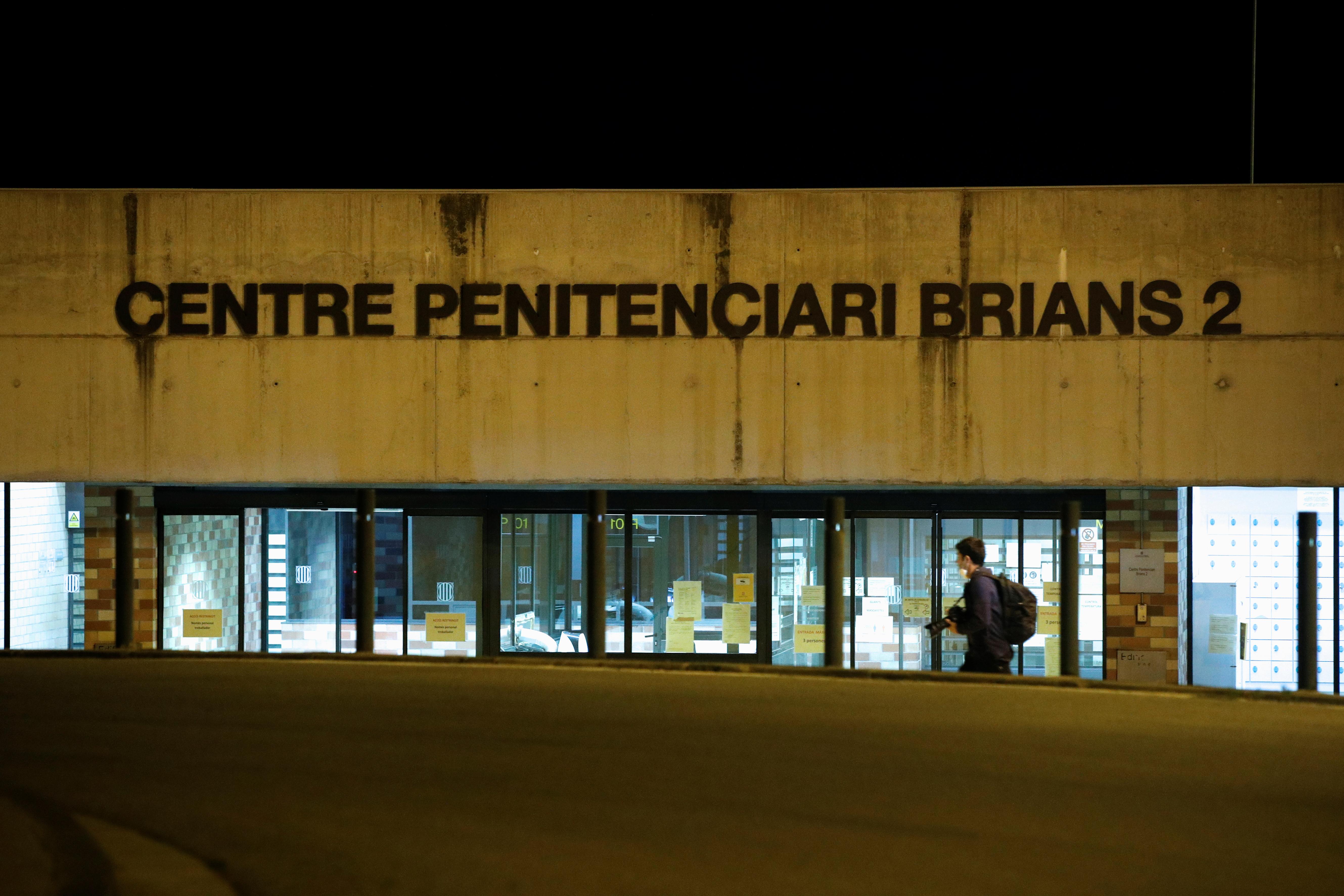 A photographer walks past the prison Brians 2 near Barcelona, Spain, June 23, 2021. REUTERS/Albert Gea