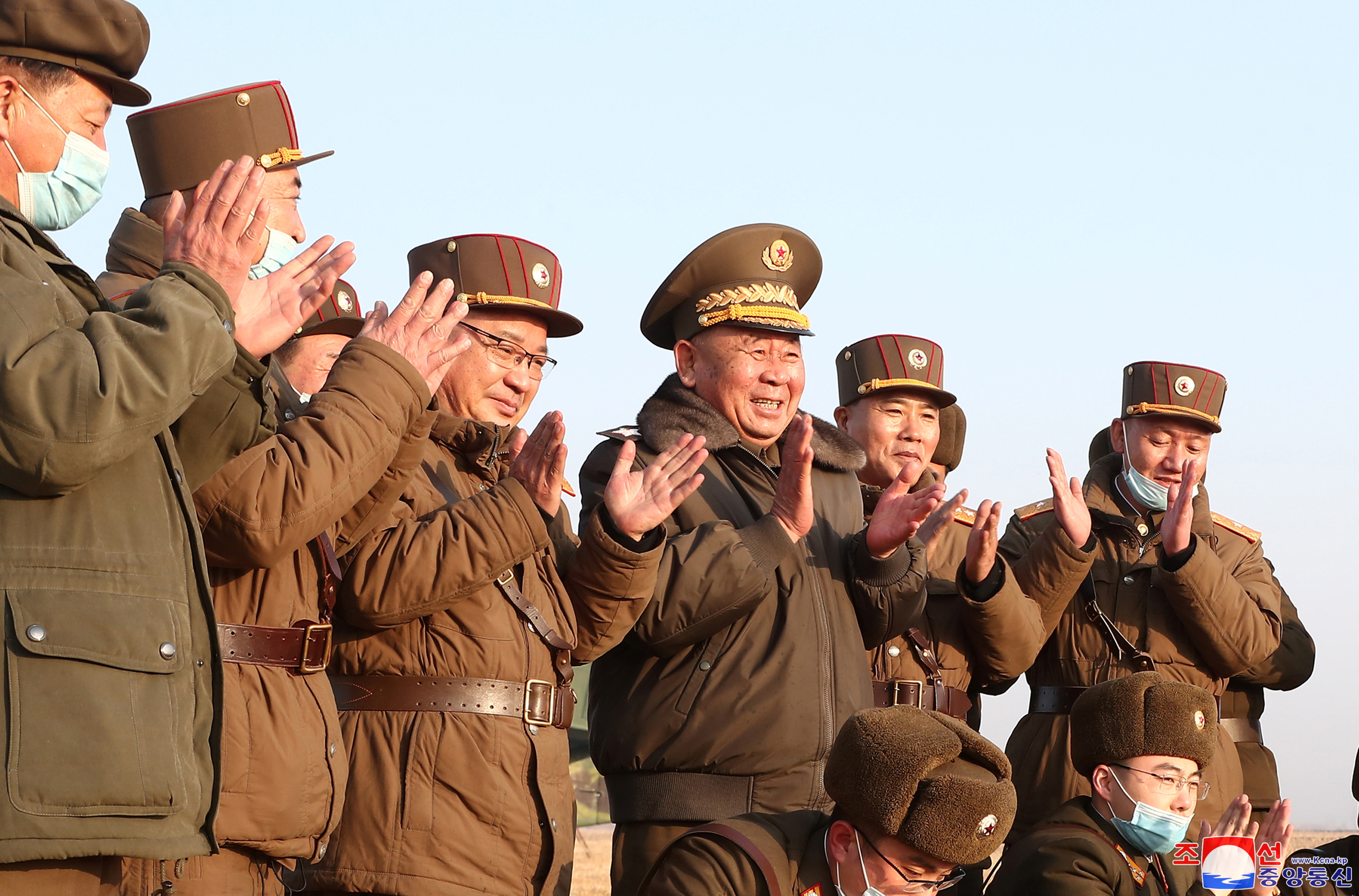 Ri Pyong Chol, the senior leader who is overseeing the test, and other military officials applaud after the launch of a newly developed new-type tactical guided projectile on March 25, 2021 in this photo released March 26, 2021 by North Korea's Korean Central News Agency (KCNA) in Pyongyang, North Korea. KCNA via REUTERS