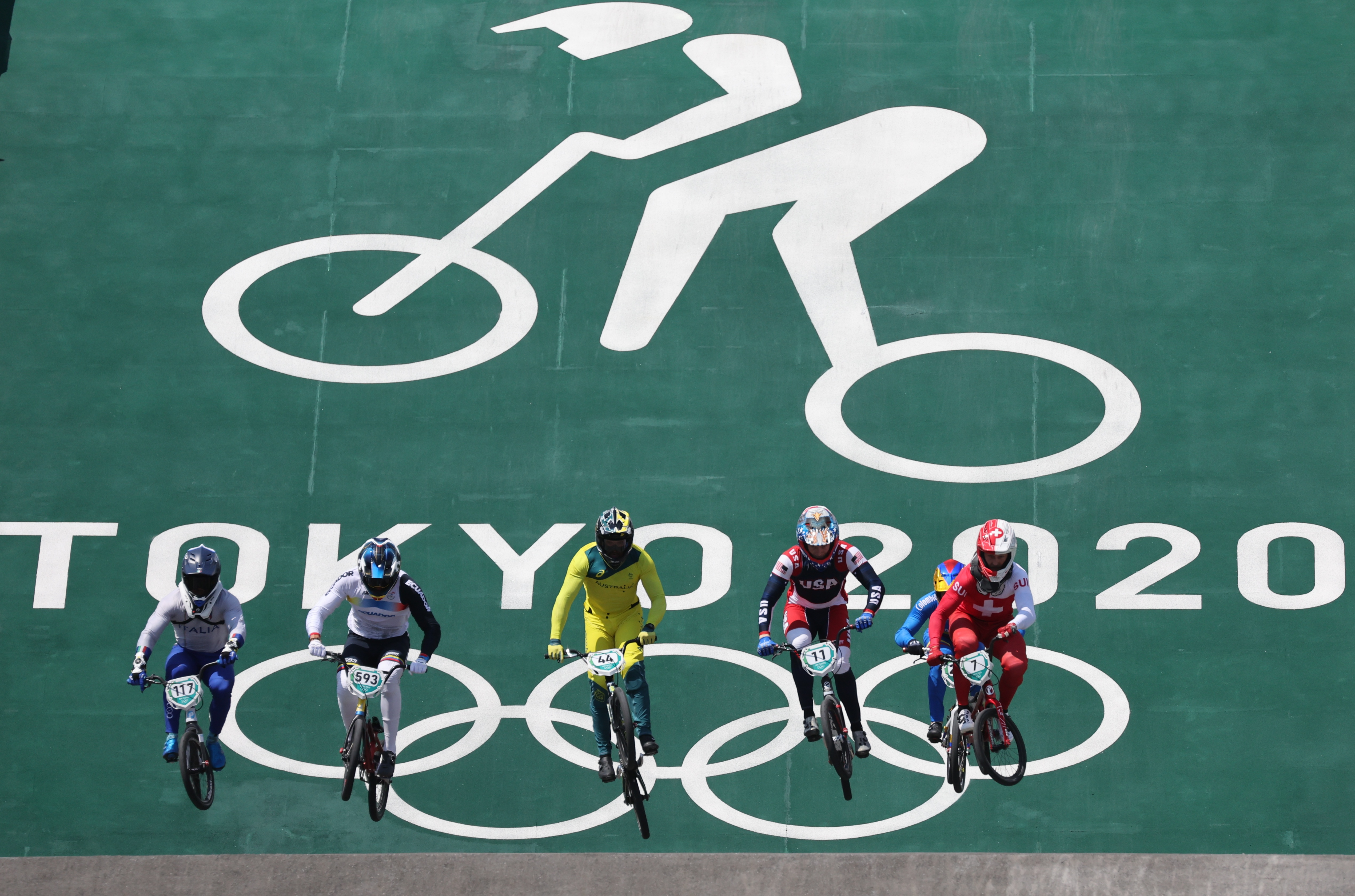 Tokyo 2020 Olympics - BMX Racing - Men's Individual - Quarterfinal - AUP - Ariake Urban Sports Park, Tokyo, Japan – July 29, 2021. Giacomo Fantoni of Italy, Alfredo Campo of Ecuador, Anthony Dean of Australia, Connor Fields of the United States, Carlos Ramirez of Colombia and David Graf of Switzerland in action. REUTERS/Christian Hartmann