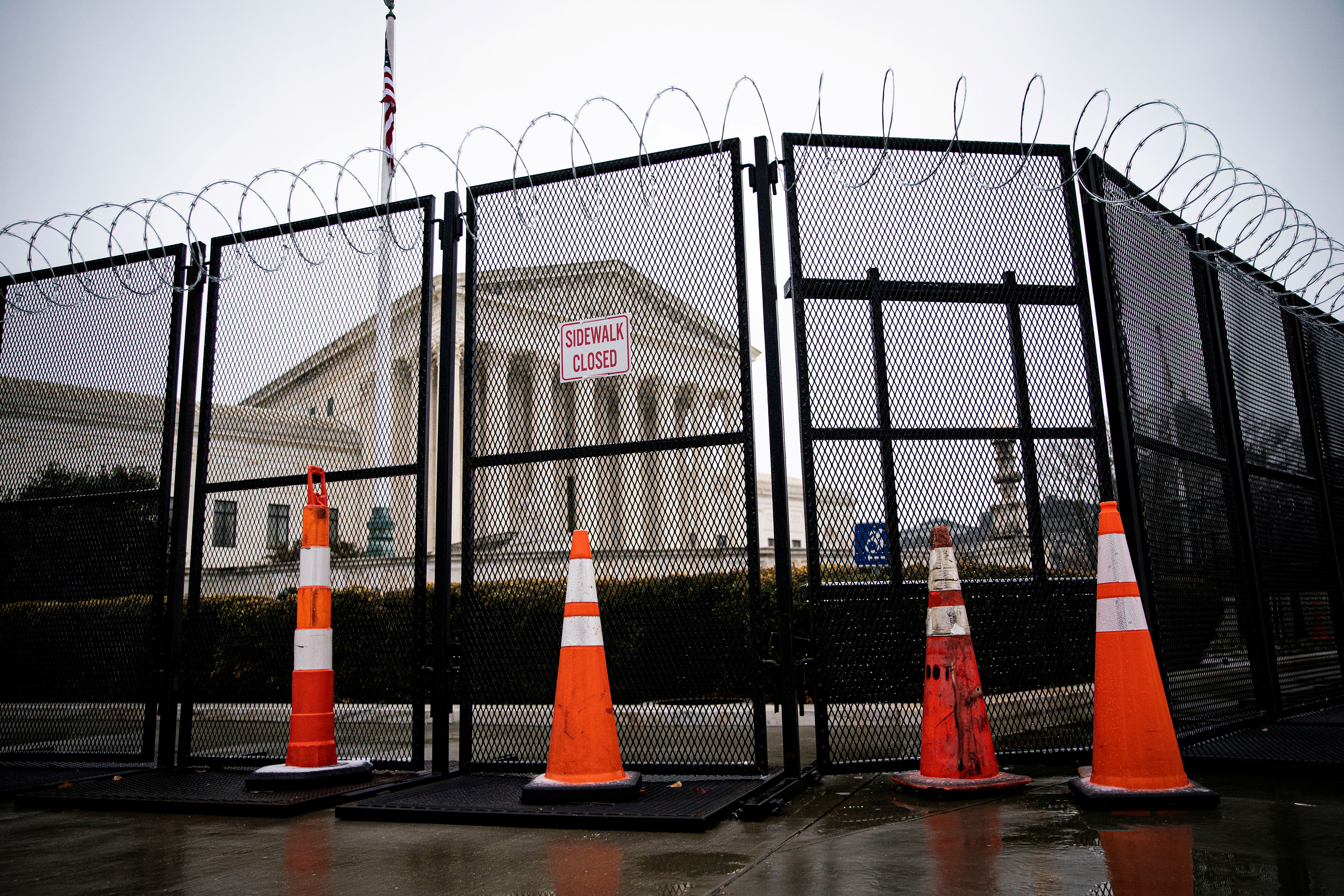 Barbed wire and security fencing surrounds the U.S. Supreme Court in Washington, U.S., January 26, 2021. REUTERS/Al Drago/File Photo