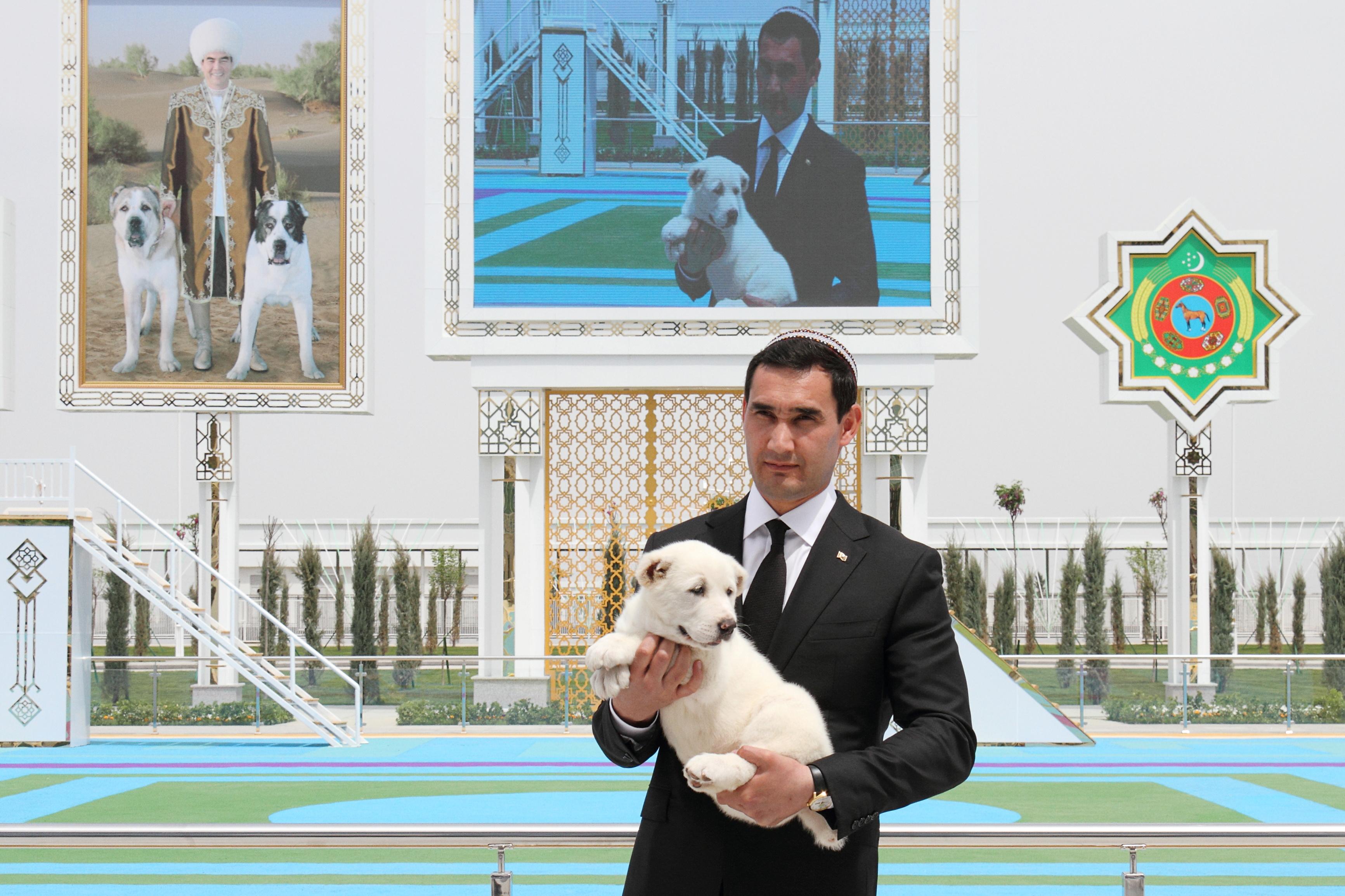 Turkmenistan's Deputy Prime Minister Serdar Berdymukhamedov, son of President Kurbanguly Berdymukhamedov, holds a puppy of a Turkmen shepherd dog, locally known as Alabai, during celebrations for the national Turkmen Horse Day and the Turkmen Shepherd Dog Day, near Ashgabat, Turkmenistan April 25, 2021. REUTERS/Vyacheslav Sarkisyan