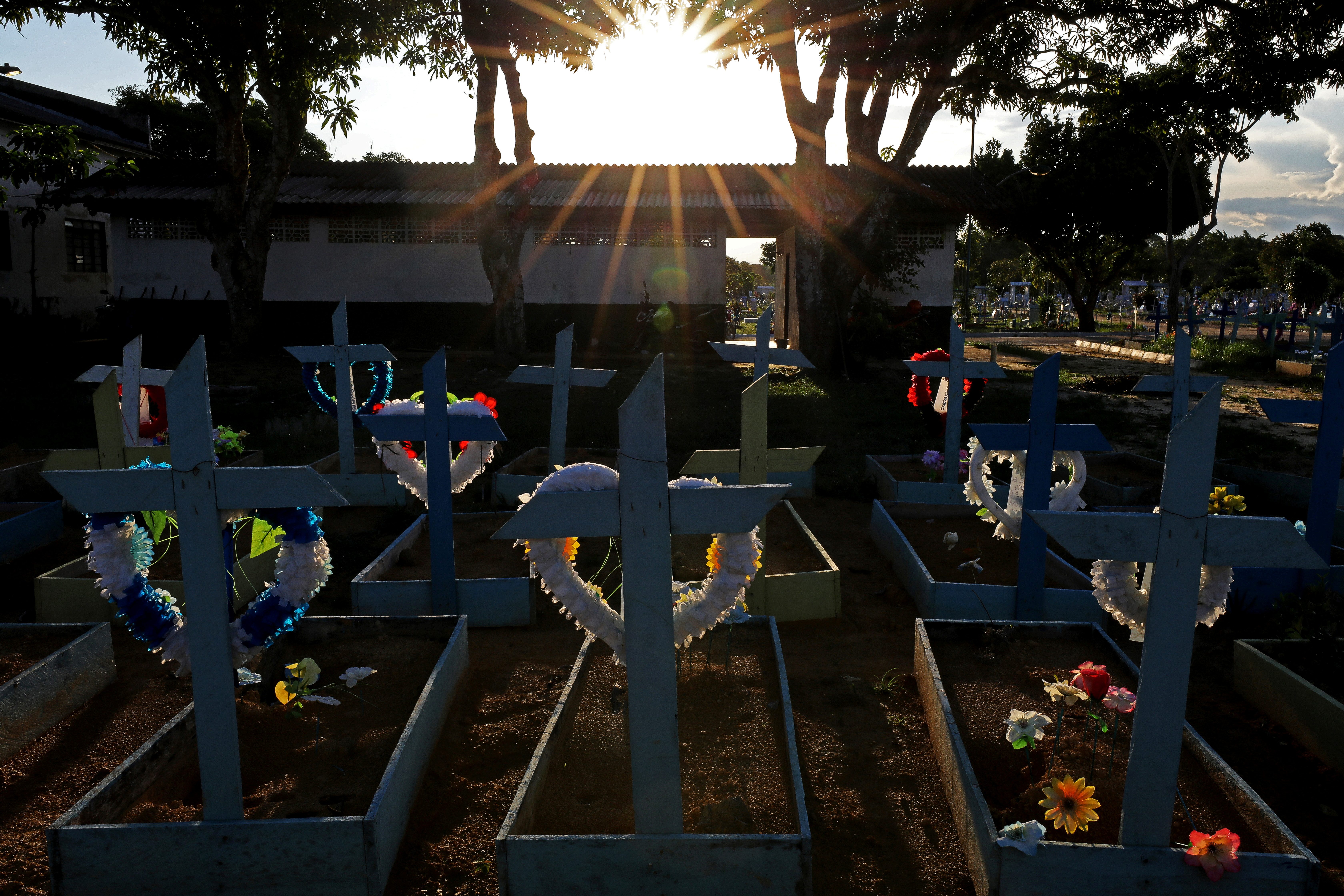 Graves of people who passed away due to the coronavirus disease (COVID-19) are pictured at the Parque Taruma cemetery in Manaus, Brazil May 20, 2021.REUTERS/Bruno Kelly
