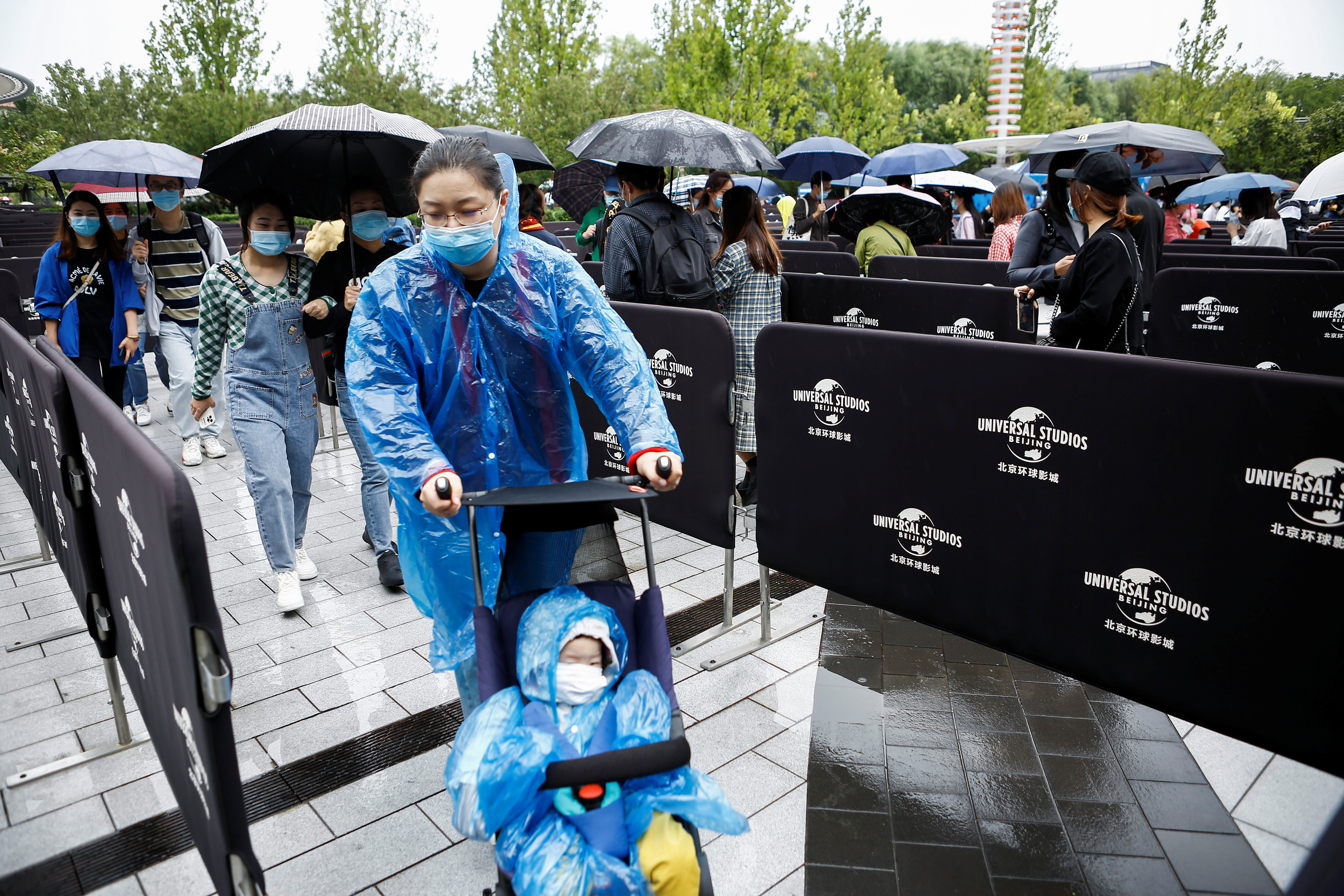 Visitors enter the Universal Beijing Resort as the Universal Studios theme park opens to the general public, in Beijing, China, September 20, 2021. REUTERS/Florence Lo