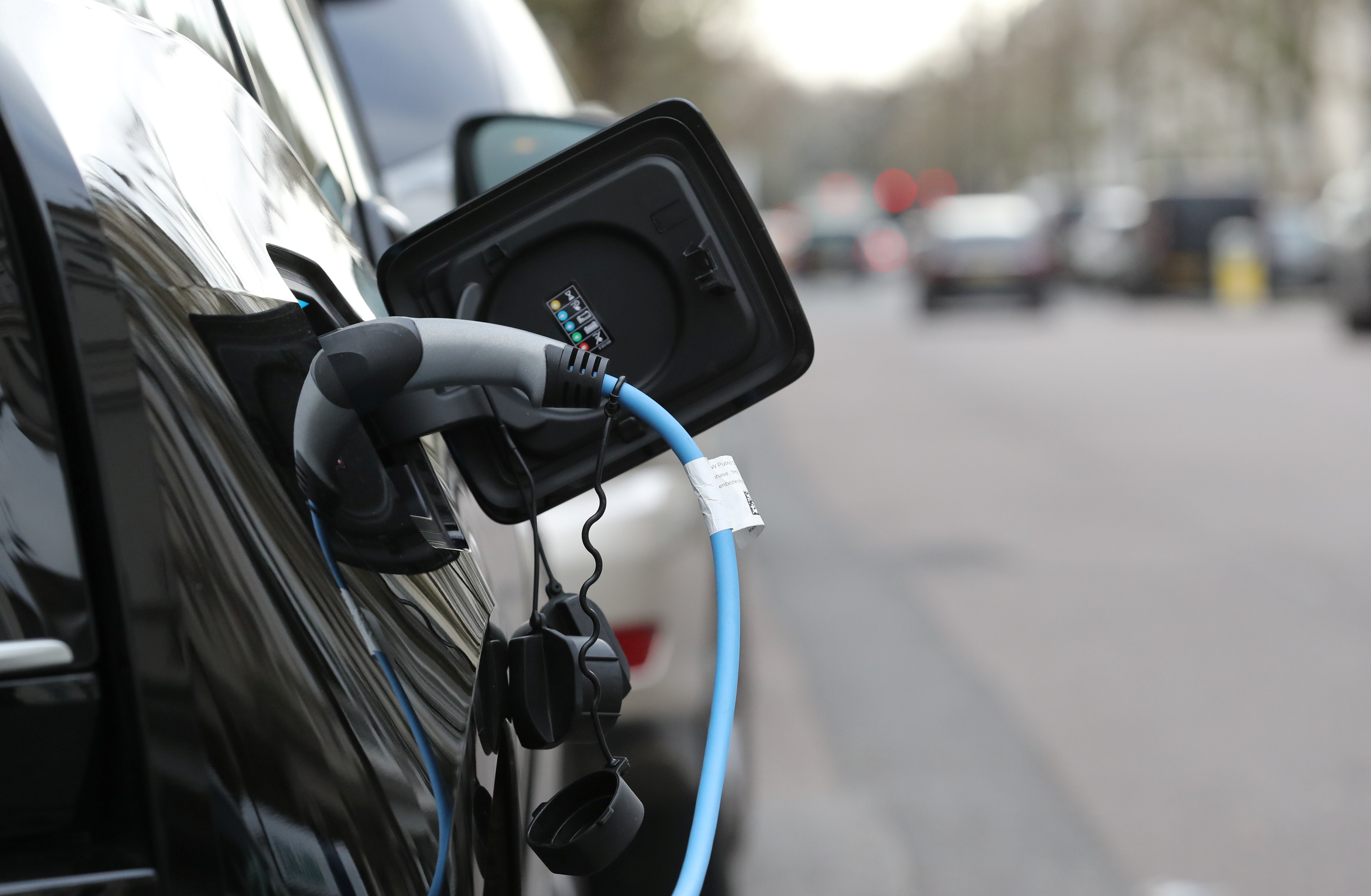 An electric car charges on a street in London, Britain, February 4, 2020.