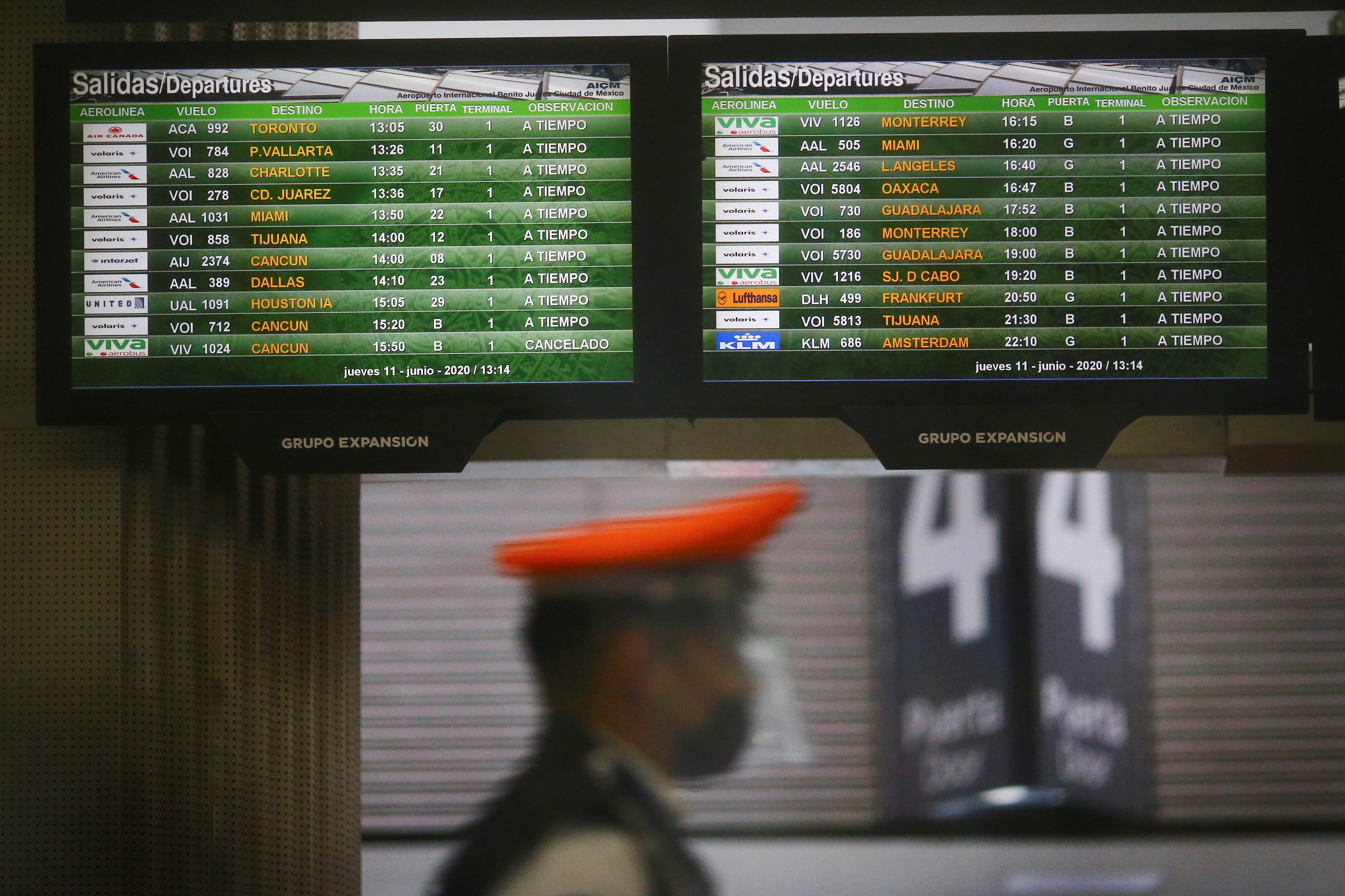 Screens show flight information at the almost empty Benito Juarez international airport, as the spread of the coronavirus disease (COVID-19) continues in Mexico City, Mexico, June 11, 2020. REUTERS/Edgard Garrido