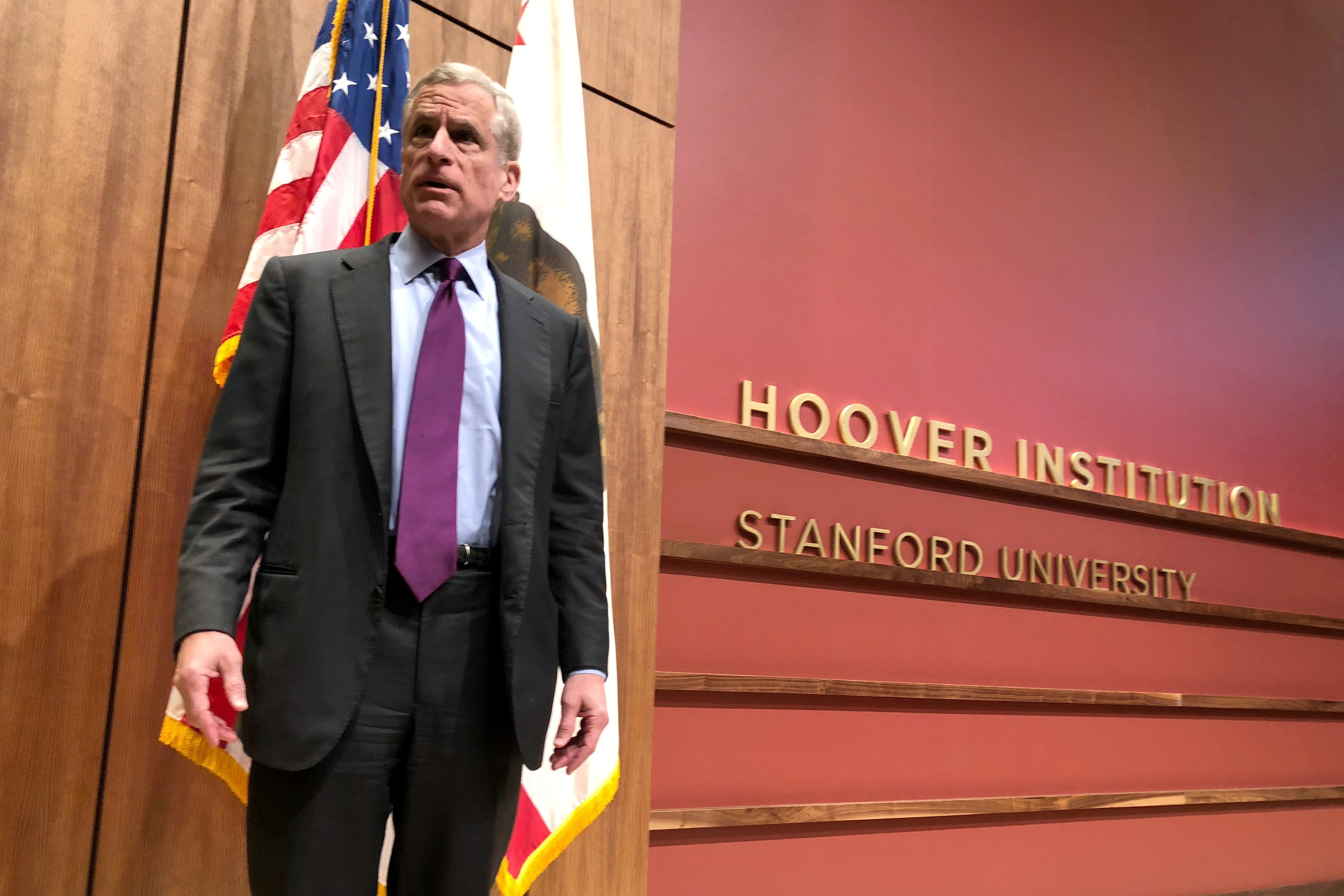 Dallas Federal Reserve Bank President Robert Kaplan stands on a stage at Stanford University's Hoover Institution where he was attending an annual monetary policy conference in Stanford, California, U.S., May 4, 2018. REUTERS/Ann Saphir