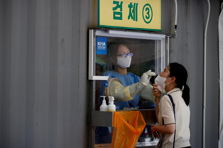 A woman gets a coronavirus disease (COVID-19) test at a coronavirus testing site in Seoul, South Korea, July 15, 2021. REUTERS/Kim Hong-Ji
