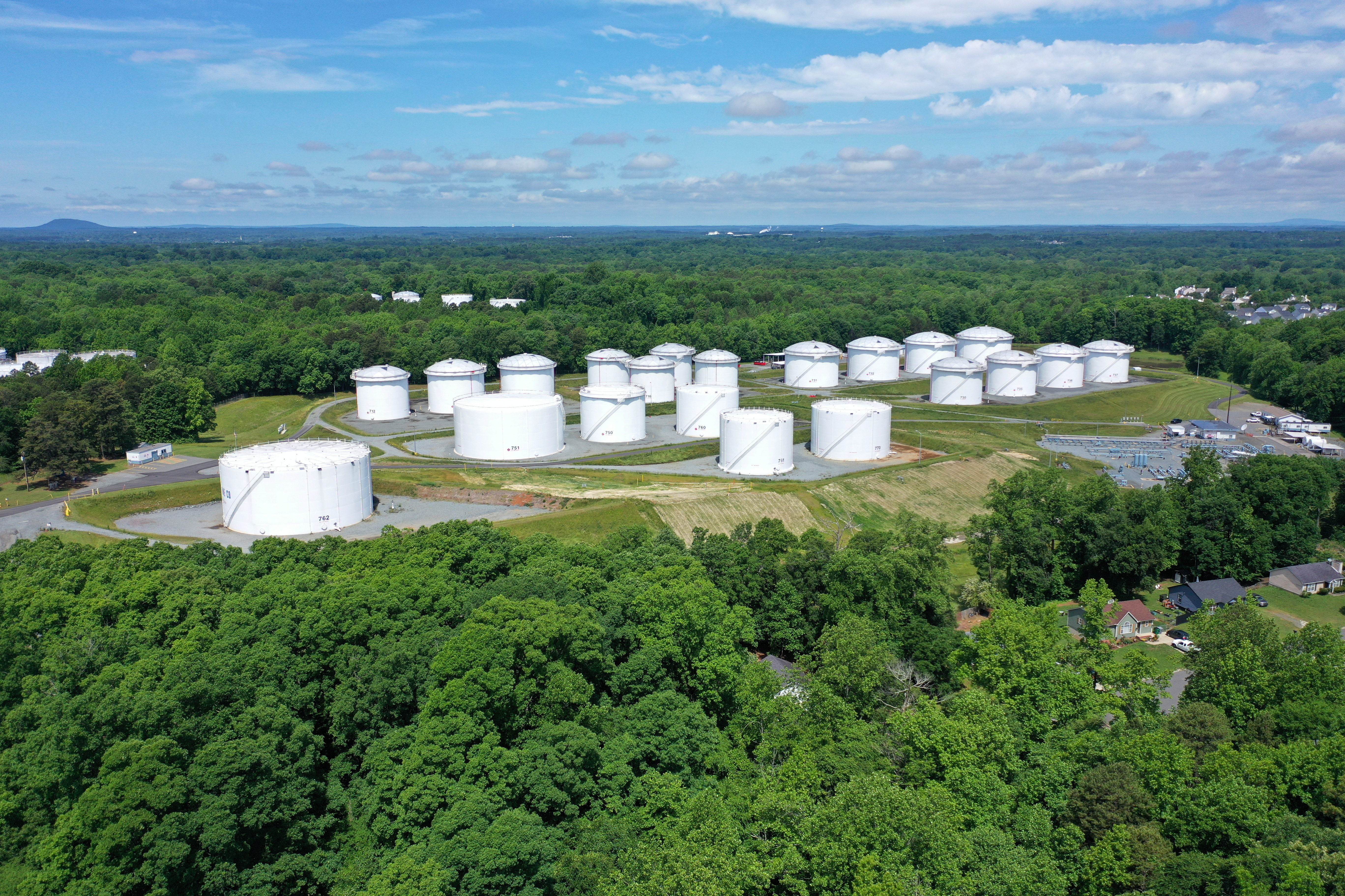 Holding tanks are seen in an aerial photograph at Colonial Pipeline's Charlotte Tank Farm in Charlotte, North Carolina, U.S. May 10, 2021. REUTERS/Drone Base
