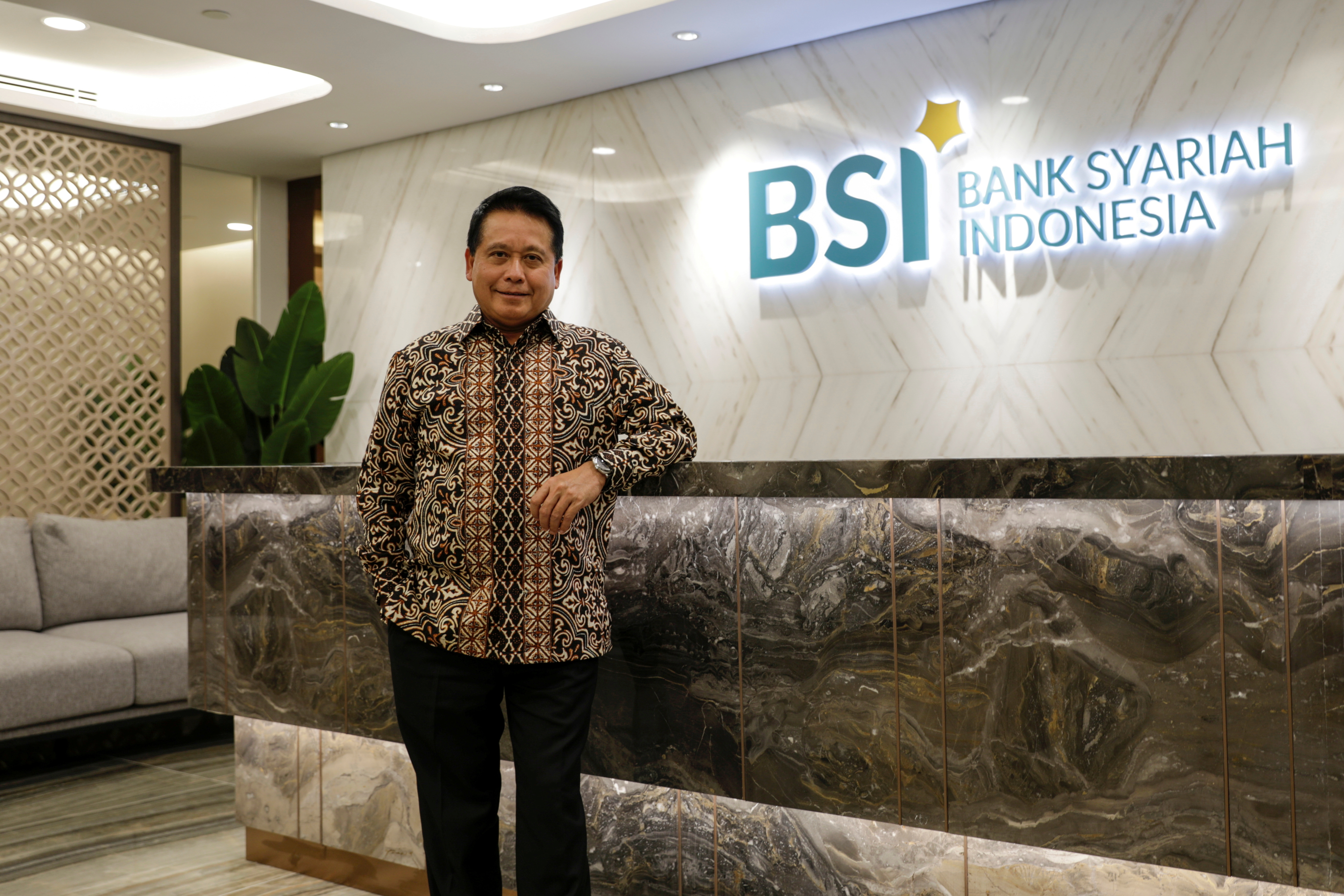 Bank Syariah Indonesia's President Director Hery Gunardi poses for pictures after an online interview in Jakarta, Indonesia, June 7, 2021. Picture taken June 7, 2021. REUTERS/Willy Kurniawan/File Photo