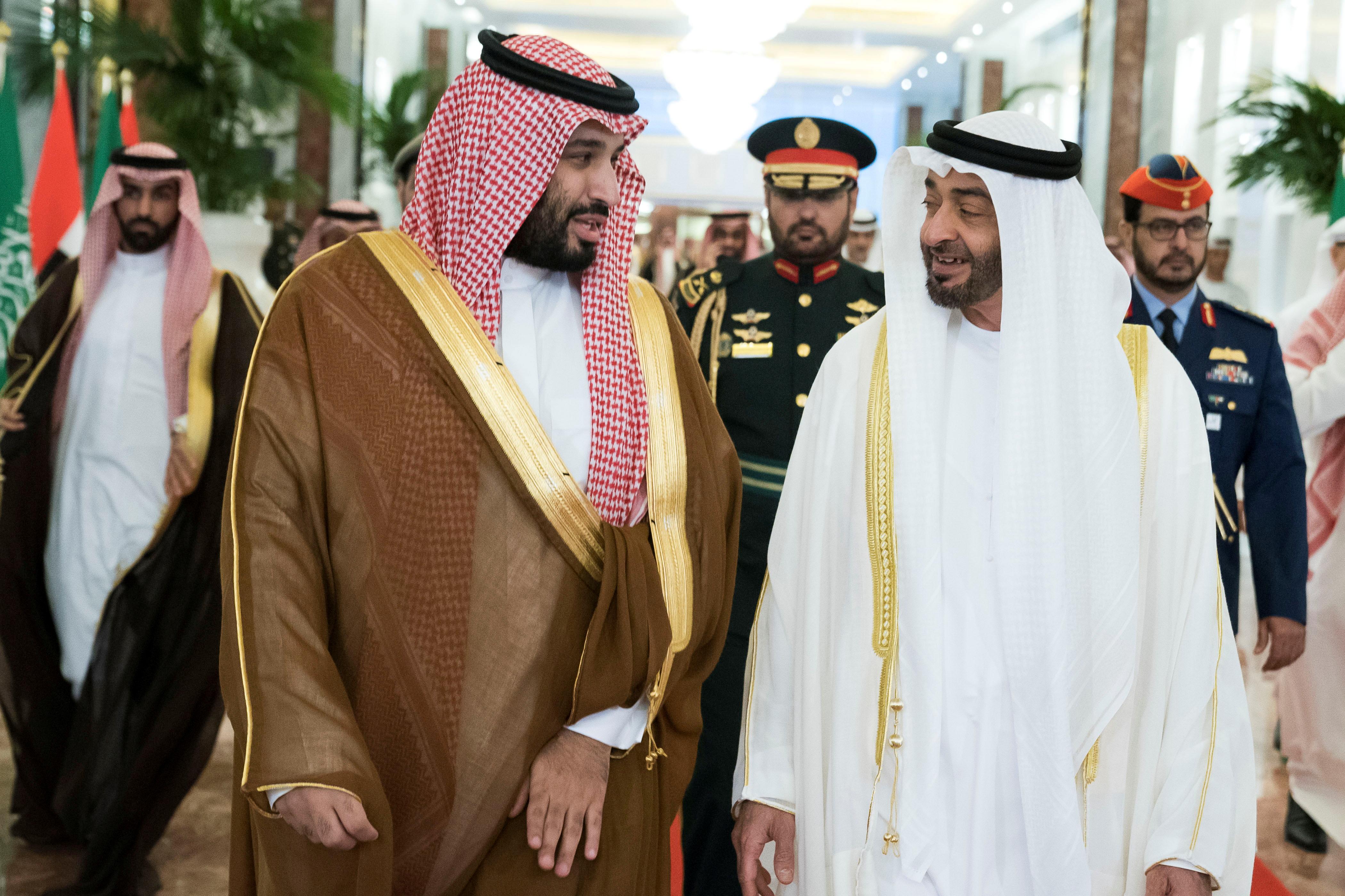 Abu Dhabi's Crown Prince Sheikh Mohammed bin Zayed al-Nahyan receives Saudi Crown Prince Mohammed bin Salman at the Presidential Airport in Abu Dhabi, United Arab Emirates November 27, 2019.  WAM/Handout via REUTERS