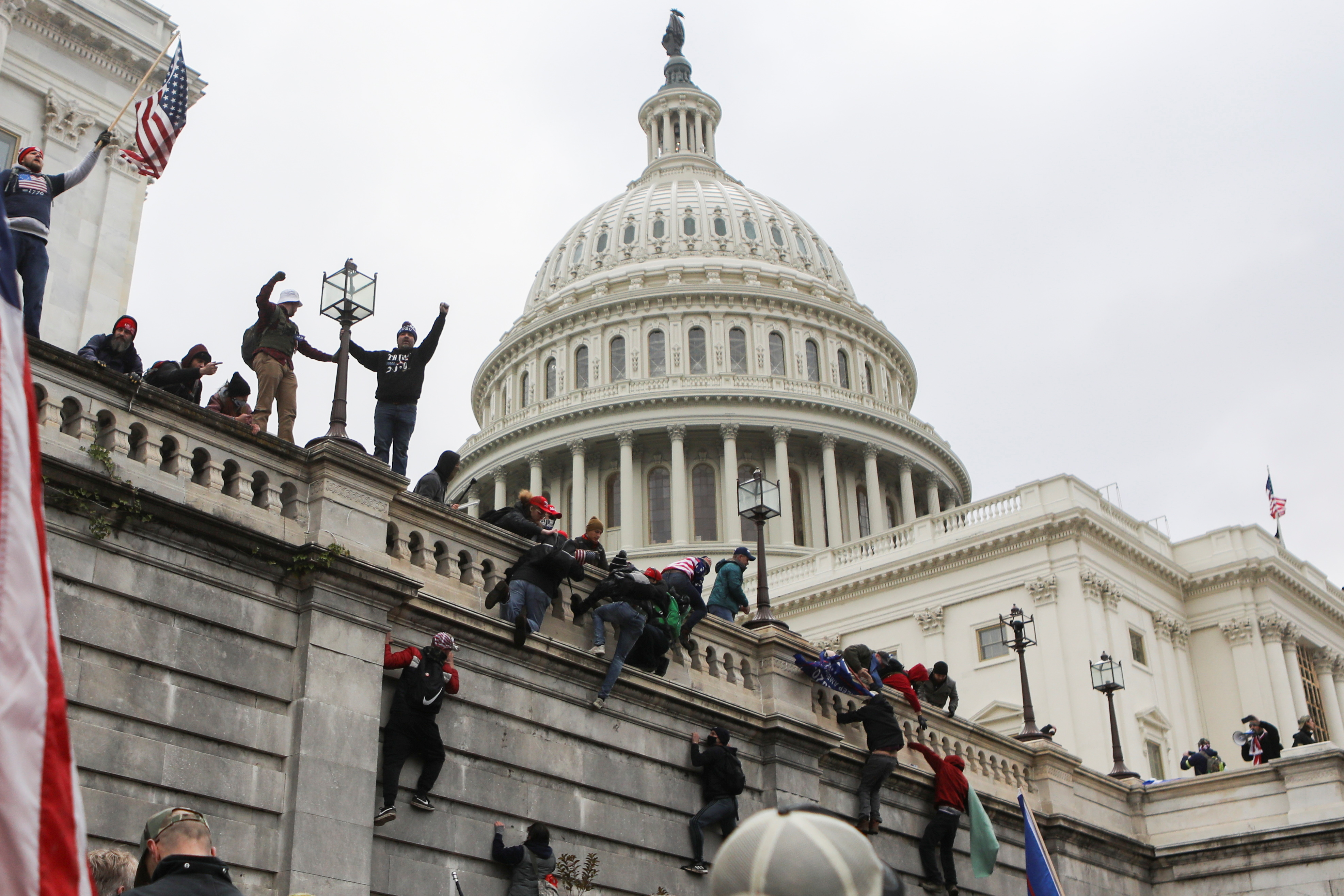 Supporters of U.S. President Donald Trump climb on walls at the U.S. Capitol during a protest against the certification of the 2020 U.S. presidential election results by the U.S. Congress, in Washington, U.S., January 6, 2021. REUTERS/Jim Urquhart