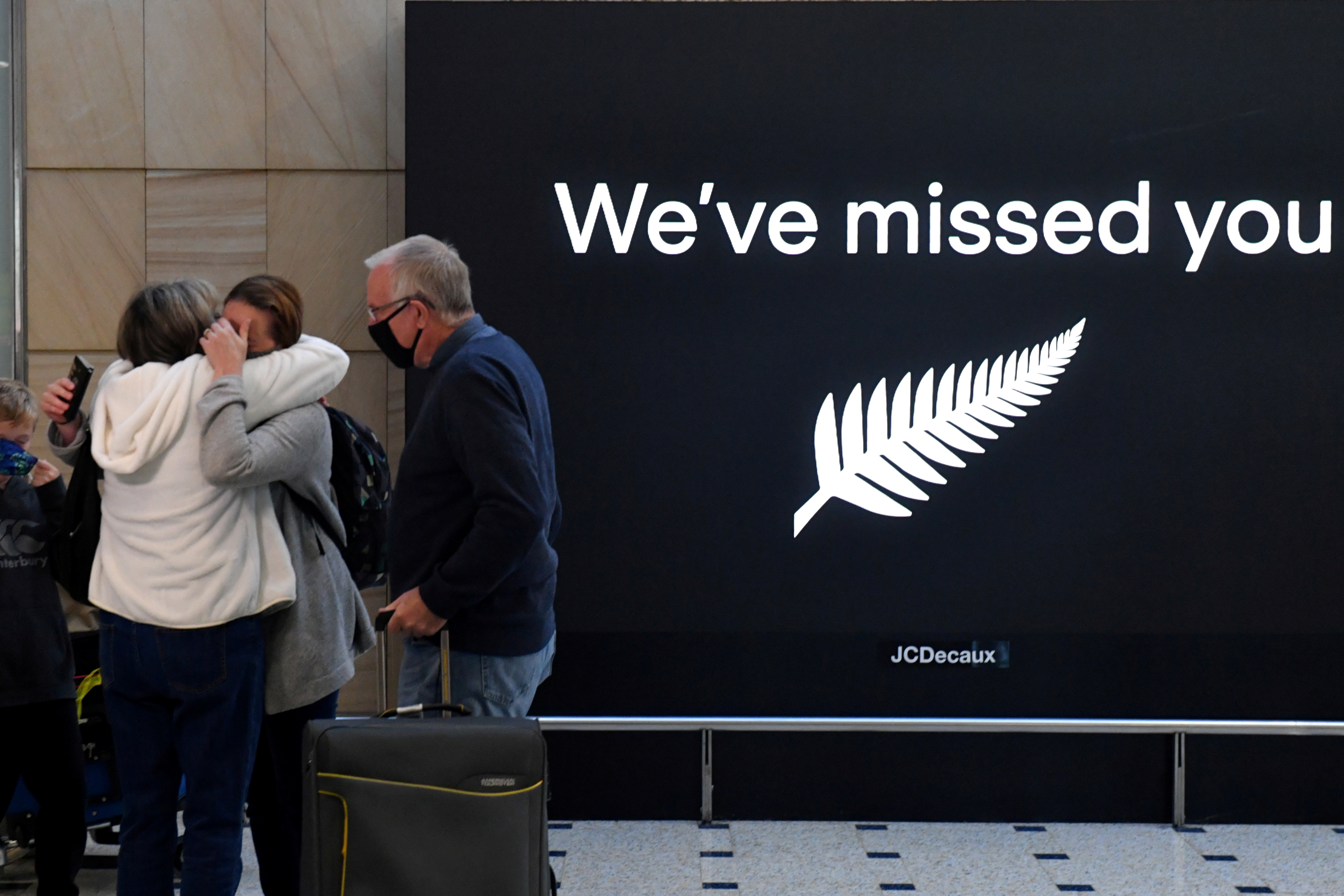 New Zealand travellers are seen as quarantine-free travel between Australia and New Zealand begins, at Sydney International Airport, Australia, April 19, 2021.   AAP Image/Mick Tsikas/via REUTERS
