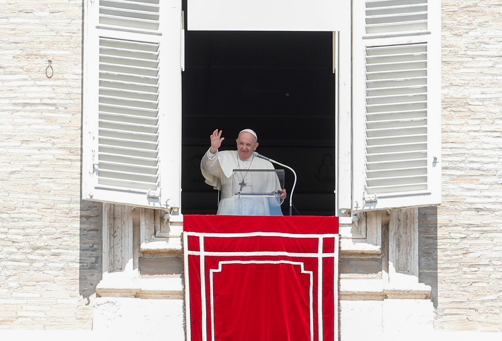 Pope Francis leads the Regina Coeli prayer from his window at St. Peter's Square at the Vatican, on April 25, 2021. REUTERS/Remo Casilli