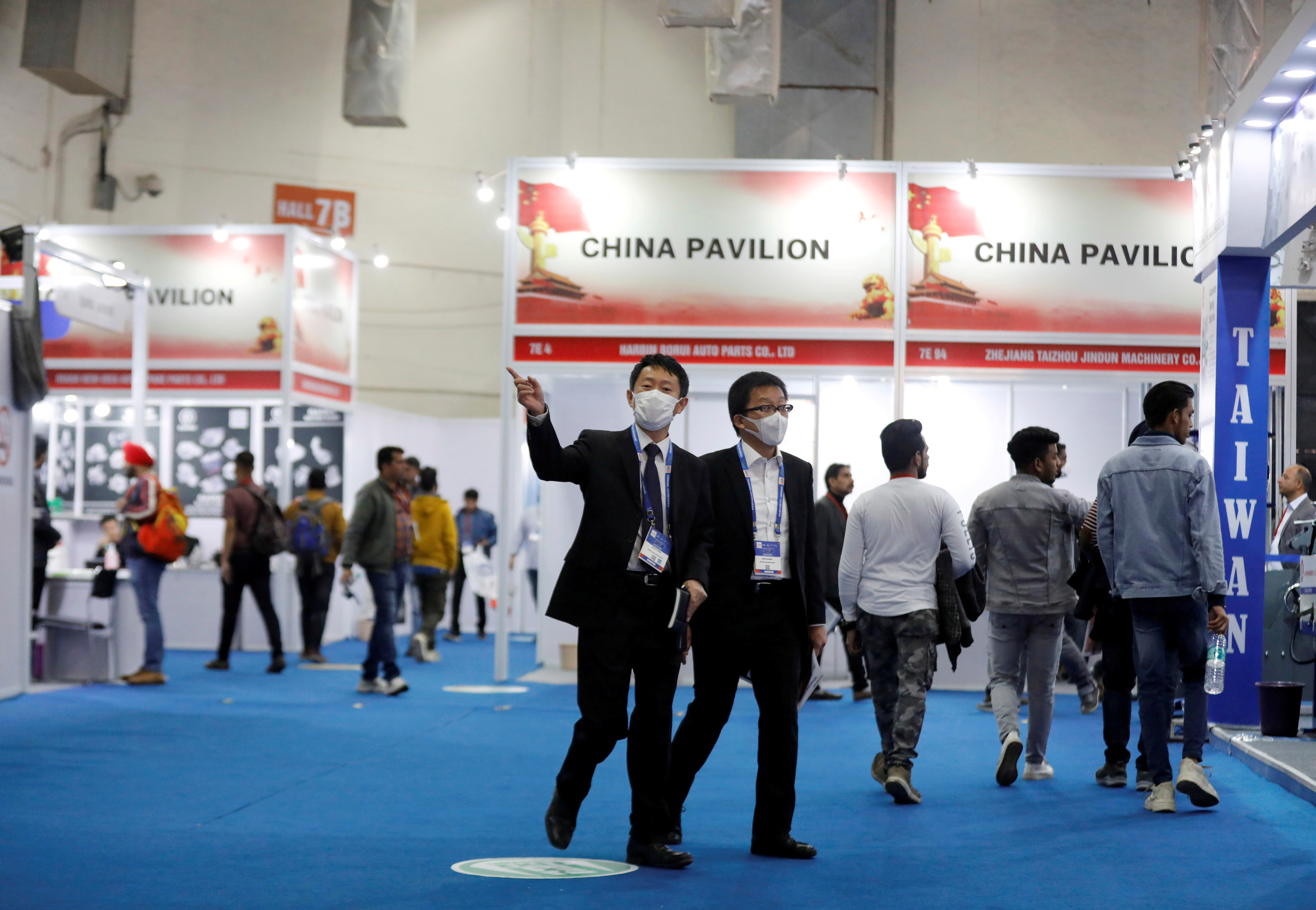 People wearing mask are seen near the stalls inside the China pavilion at the India Auto Expo 2020 - Components in New Delhi, India, February 6, 2020. REUTERS/Anushree Fadnavis/File Photo
