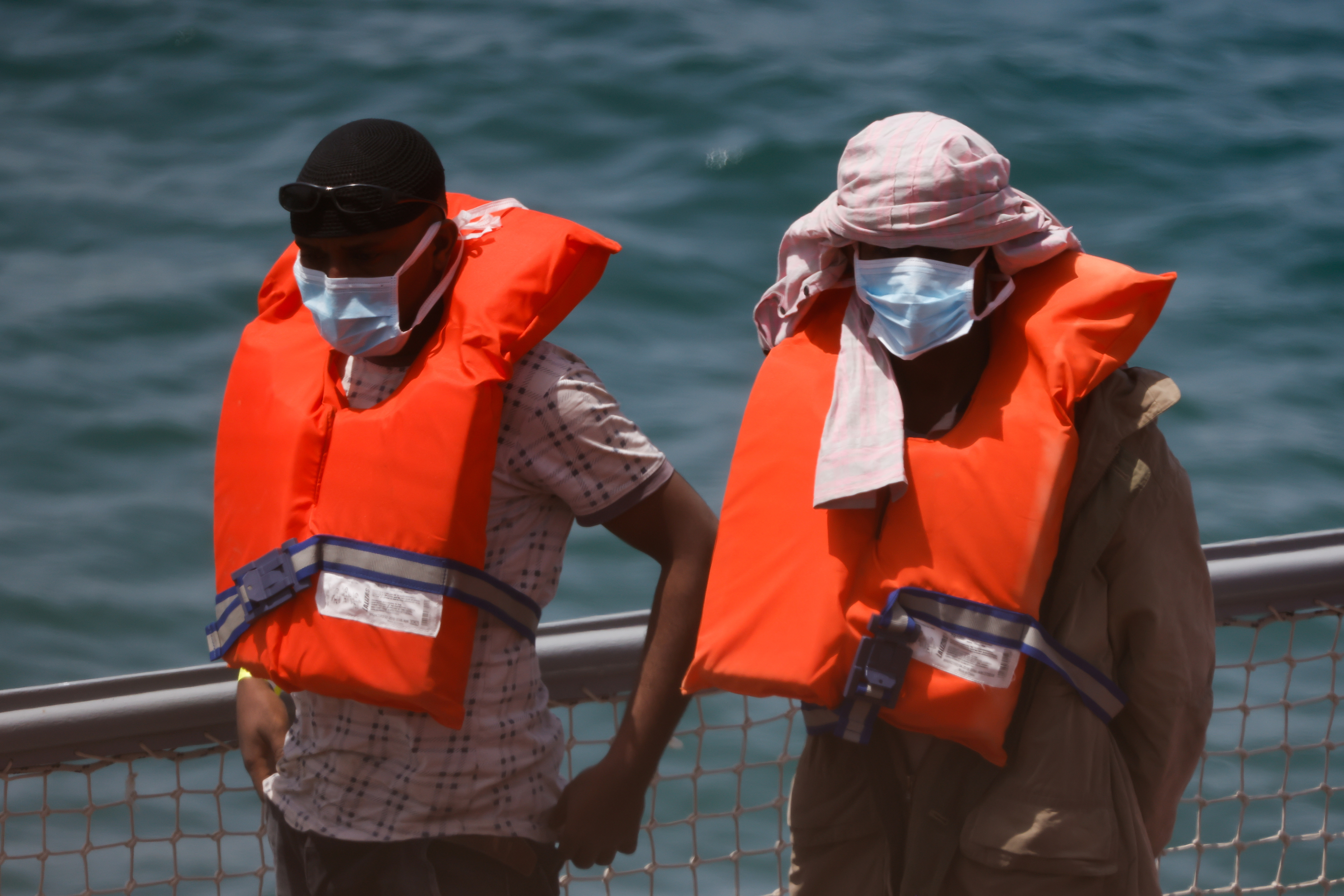 Rescued migrants disembark from an Armed Forces of Malta vessel in Senglea, in Valletta's Grand Harbour, as the coronavirus disease (COVID-19) outbreak continues in Malta May 11, 2021. REUTERS/Darrin Zammit Lupi