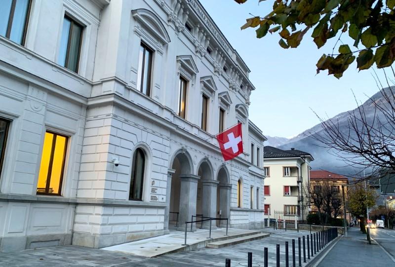Switzerland's national flag is displayed on the Swiss Federal Criminal Court (Bundesstrafgericht) building in Bellinzona, Switzerland, December 3, 2020. REUTERS/Emma Farge/File Photo