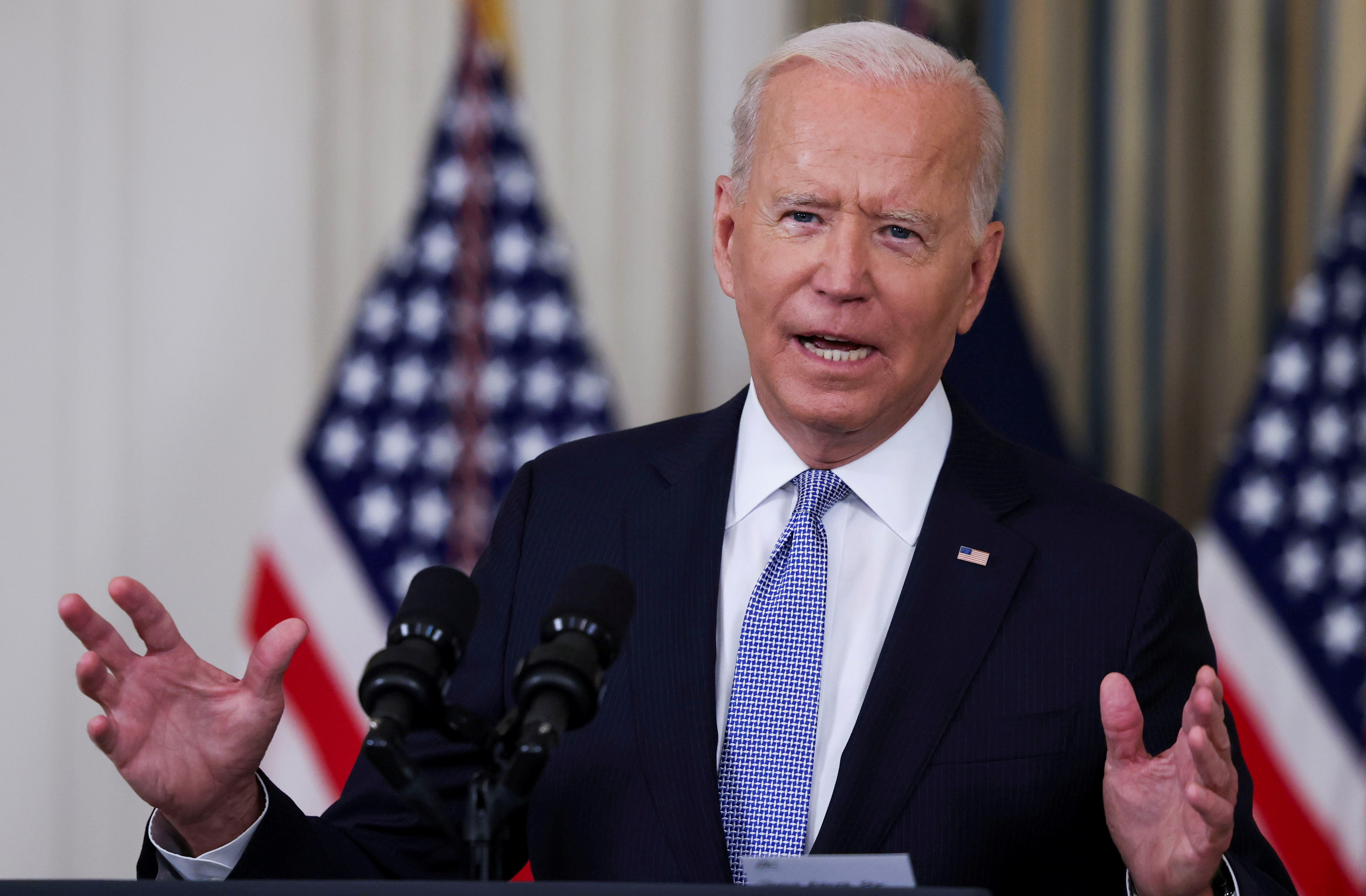 U.S. President Joe Biden responds to a question from a reporter after speaking about coronavirus disease (COVID-19) vaccines and booster shots in the State Dining Room at the White House in Washington, U.S., September 24, 2021. REUTERS/Evelyn Hockstein