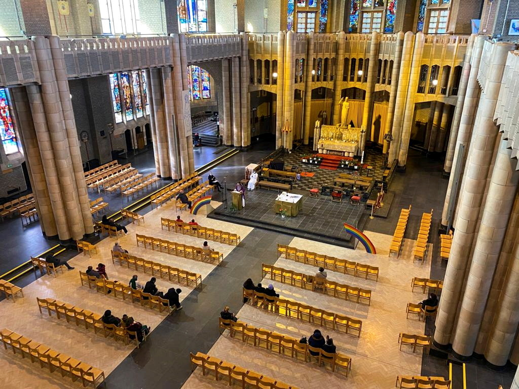 Parishioners, who can only gather in a group of maximum of 15 people at the same time in the building, attend a mass in the Belgium's national Koekelberg basilica, one of the largest churches in the world, amid the coronavirus disease (COVID-19) outbreak in Brussels, Belgium February 21, 2021. REUTERS/Johnny Cotton