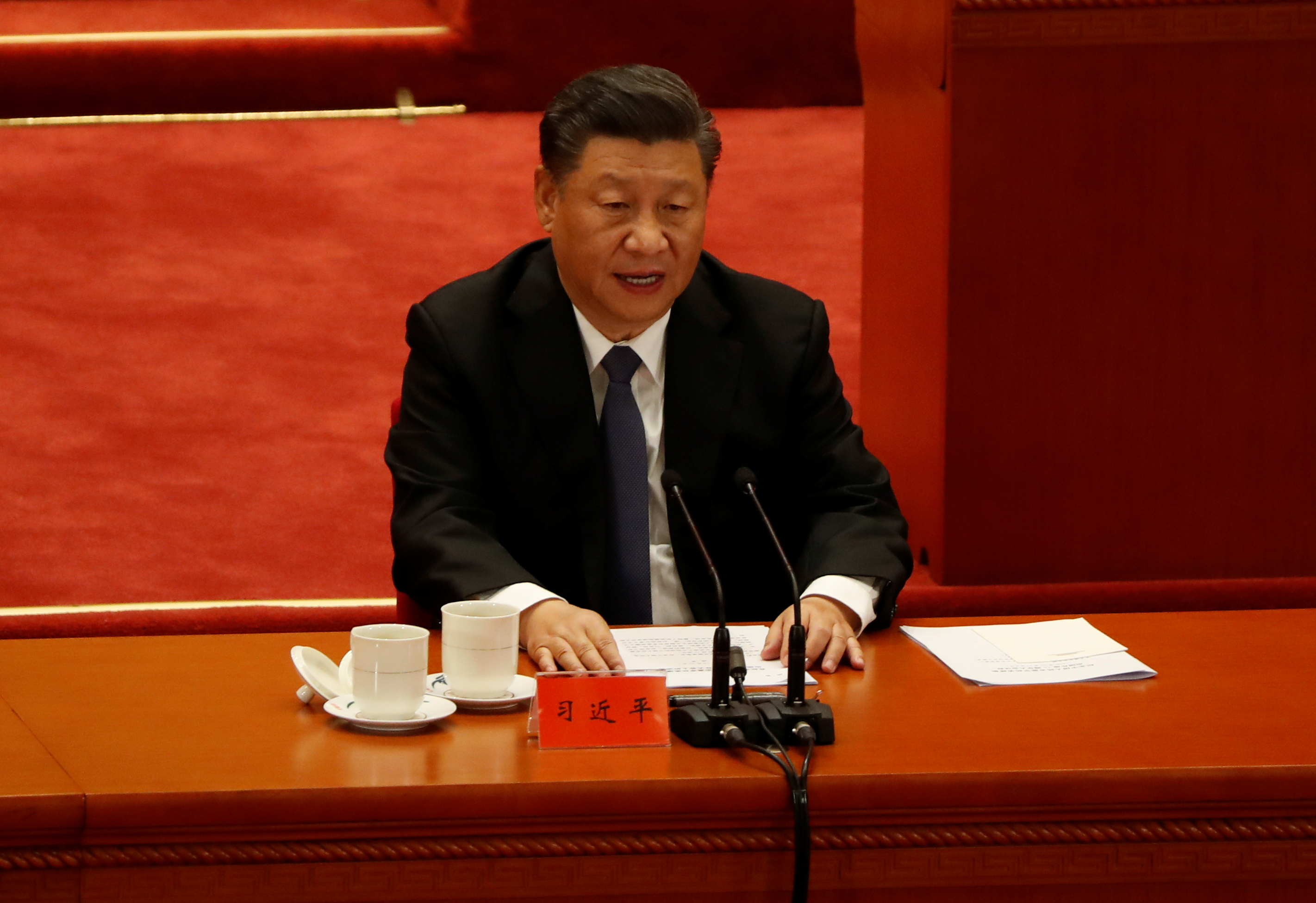 China's President Xi Jinping speaks while taking part in an event marking the 70th anniversary of the Chinese People's Volunteer Army's participation in the Korean War at the Great Hall of the People in Beijing, China October 23, 2020. REUTERS/Carlos Garcia Rawlins