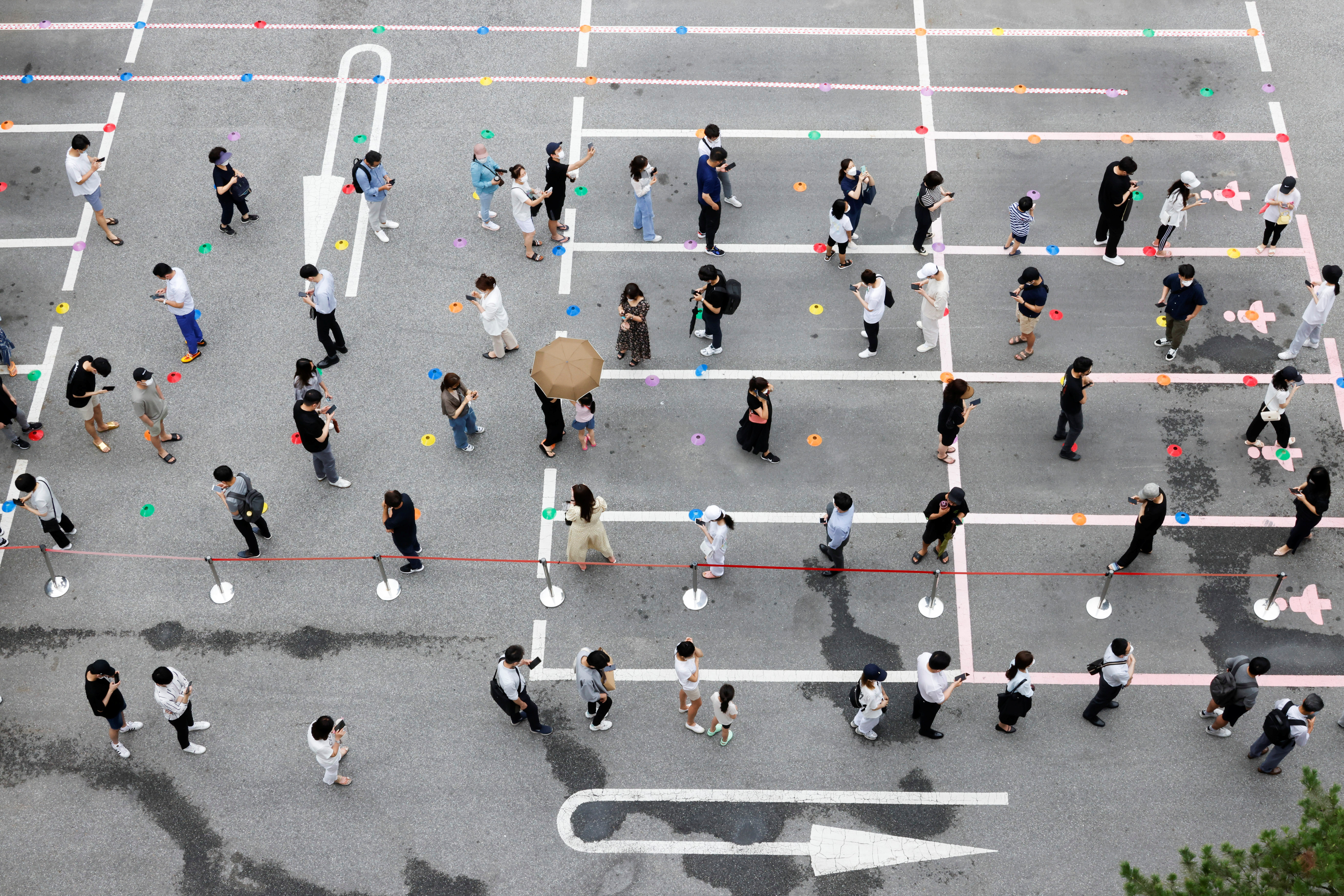 People wait in line for a coronavirus disease (COVID-19) test at a testing site which is temporarily set up at a public health center in Seoul, South Korea, July 9, 2021.  REUTERS/ Heo Ran