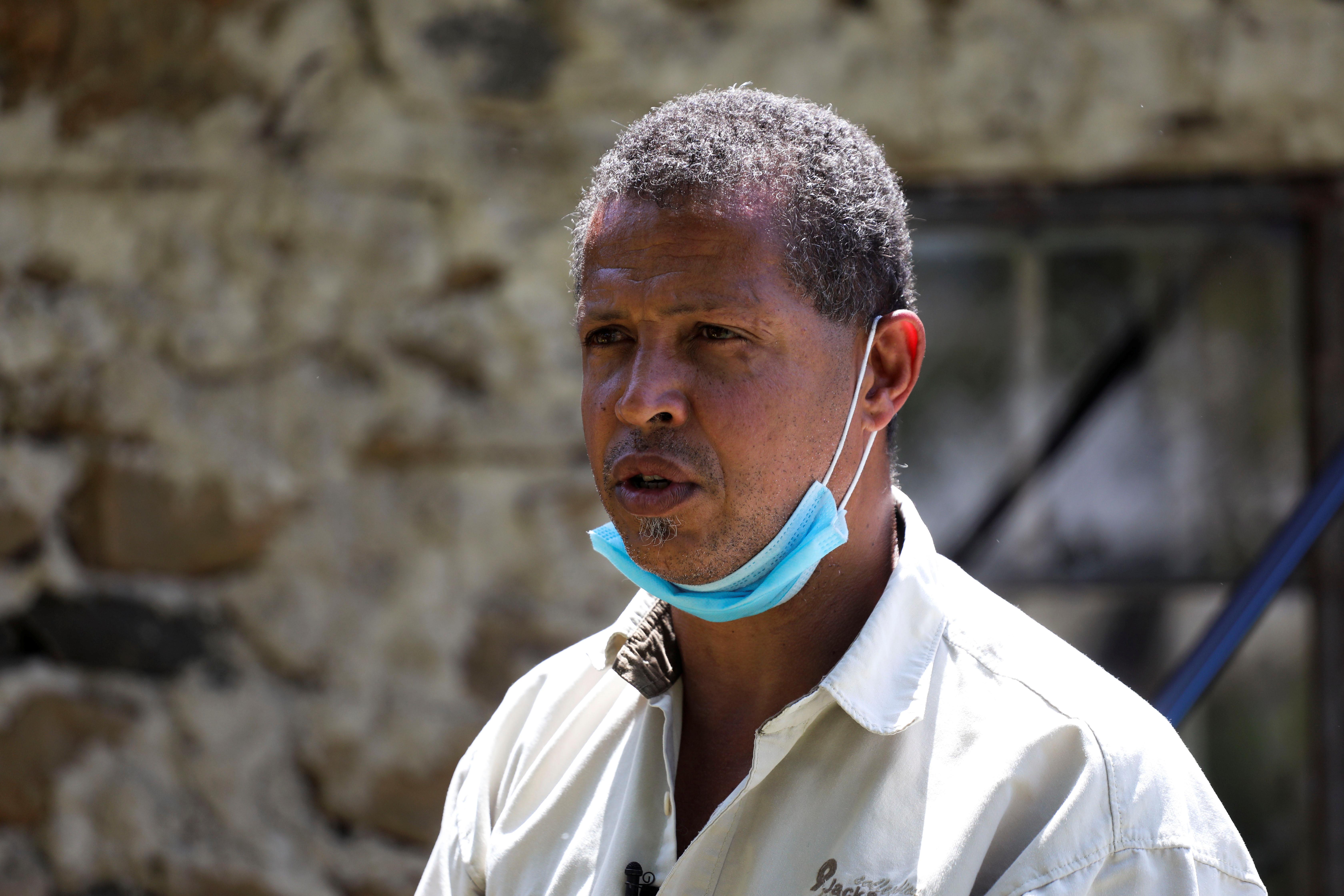 Entrepreneur Dominic Kahumbu speaks during an interview with Reuters, near the town of Kisumu, Kenya June 9, 2021. REUTERS/Baz Ratner