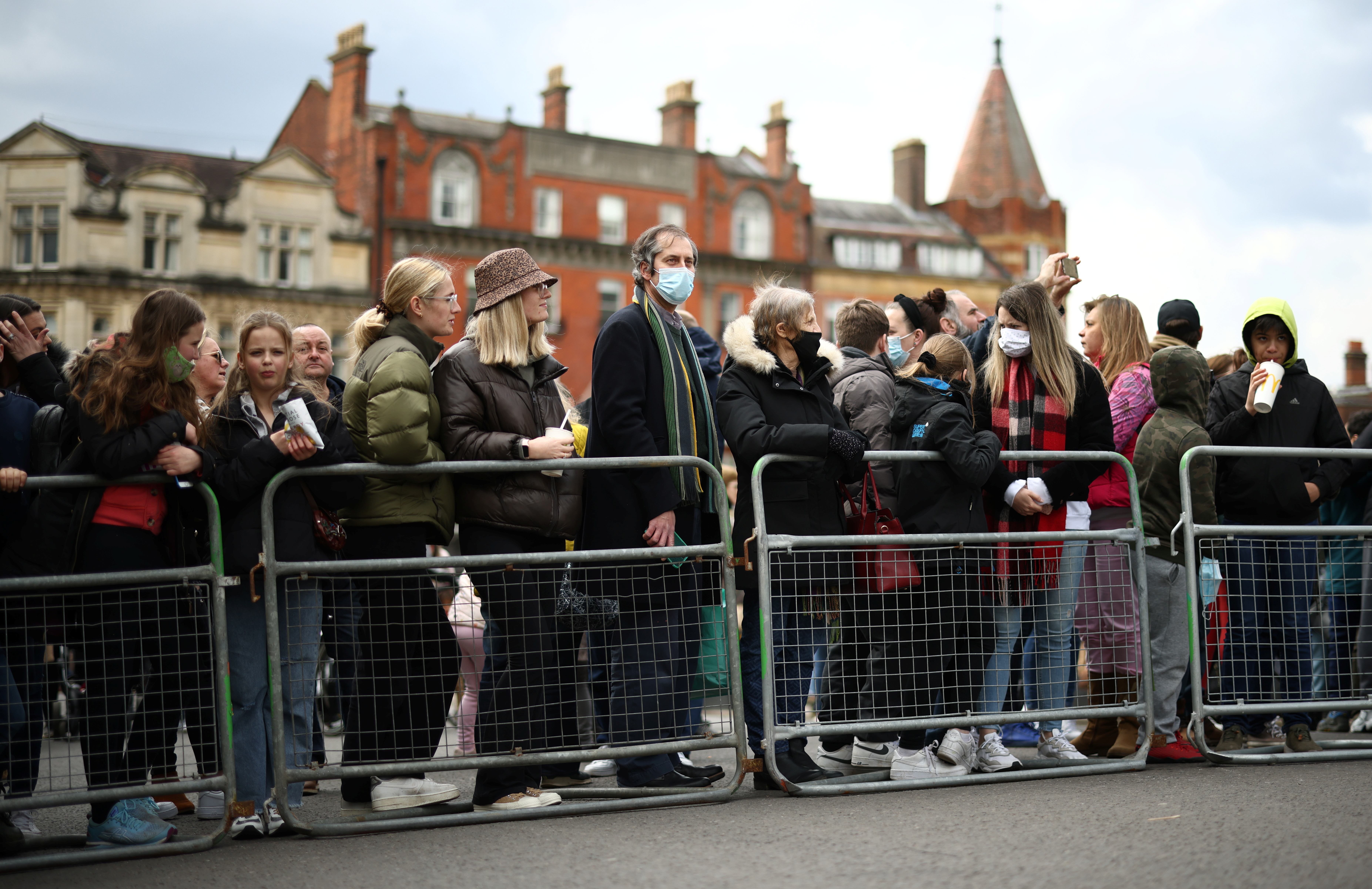 People gather outside Windsor Castle after Britain's Prince Philip, husband of Queen Elizabeth, died at the age of 99, in Windsor, near London, Britain, April 11, 2021. REUTERS/Henry Nicholls