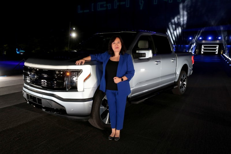 Chief engineer Linda Zhang poses next to the all-electric Ford F-150 Lightning pickup truck during the unveiling at the company's world headquarters in Dearborn, Michigan, U.S., May 19, 2021. REUTERS/Rebecca Cook/File Photo