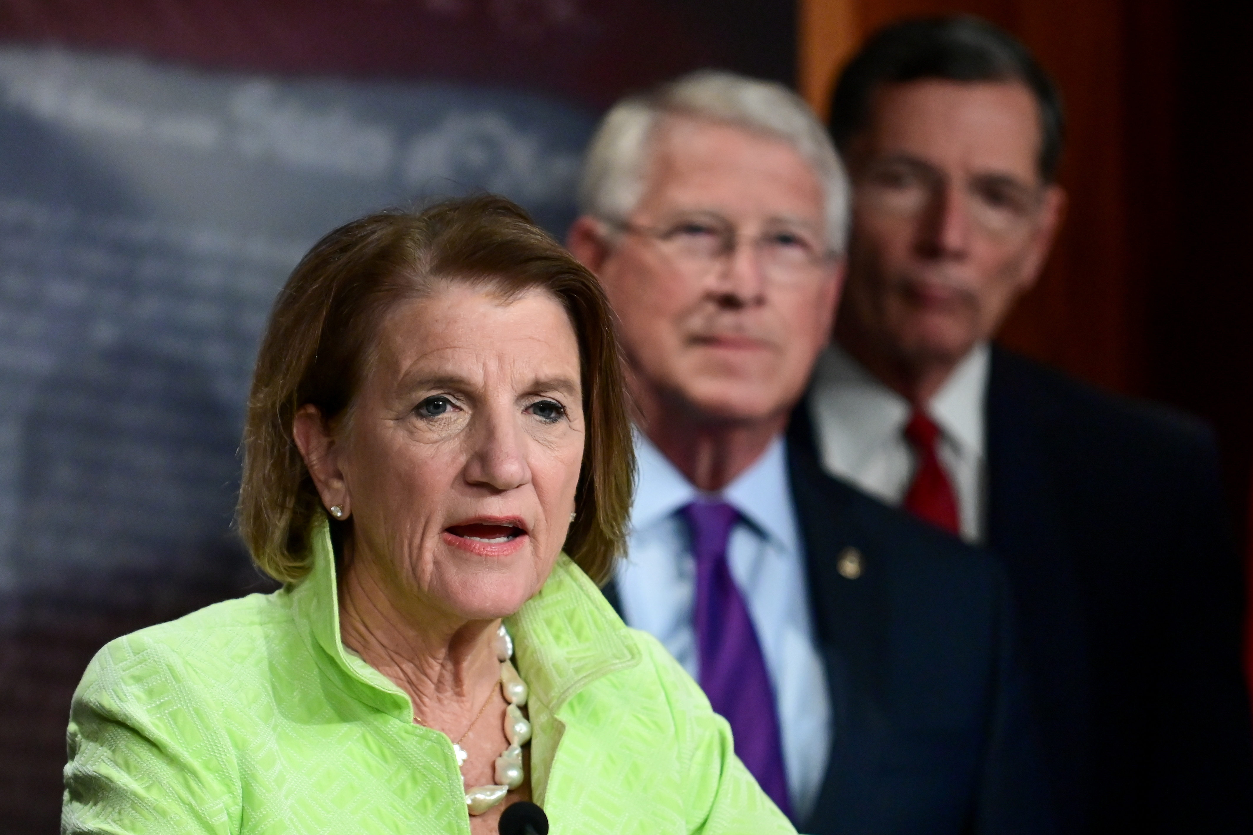 Shelley Capito (R-WV) speaks during a news conference to introduce the Republican infrastructure plan, as Roger Wicker (R-MS) and John Barrasso (R-WY) stand behind her, at the U.S. Capitol in Washington, U.S., April 22, 2021. REUTERS/Erin Scott