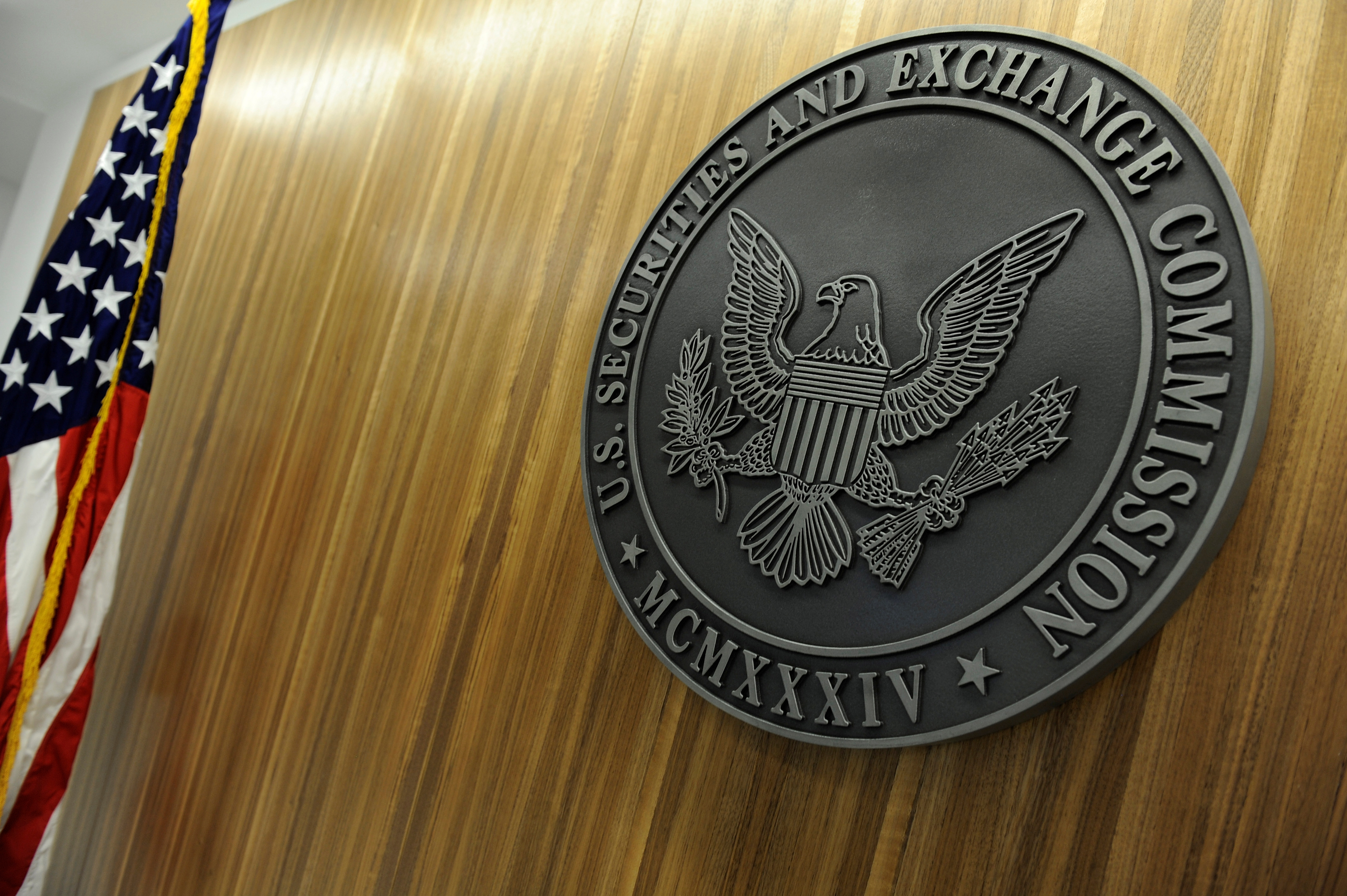 The seal of the U.S. Securities and Exchange Commission hangs on the wall at SEC headquarters in Washington, June 24, 2011. REUTERS/Jonathan Ernst/File Photo
