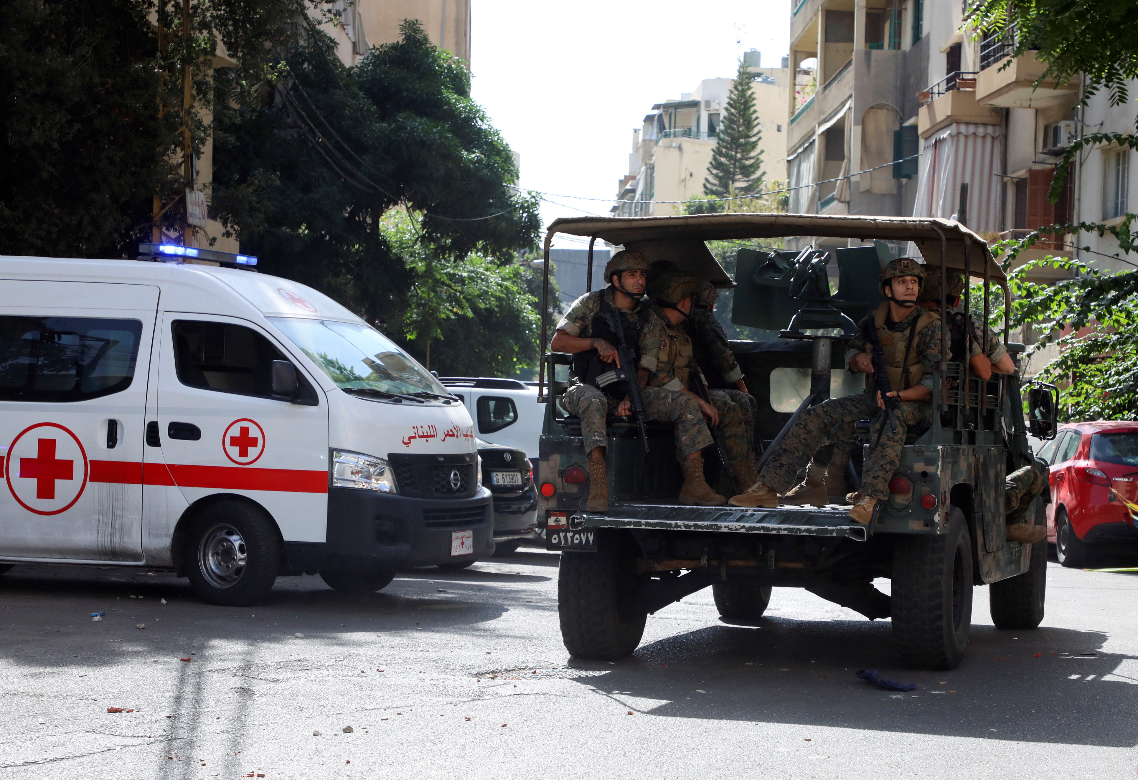 A Lebanese Red Cross vehicle is pictured as army soldiers are deployed after gunfire erupted near the site of a protest that was getting underway against Judge Tarek Bitar, who is investigating last year's port explosion, in Beirut, Lebanon October 14, 2021. REUTERS/Mohamed Azakir