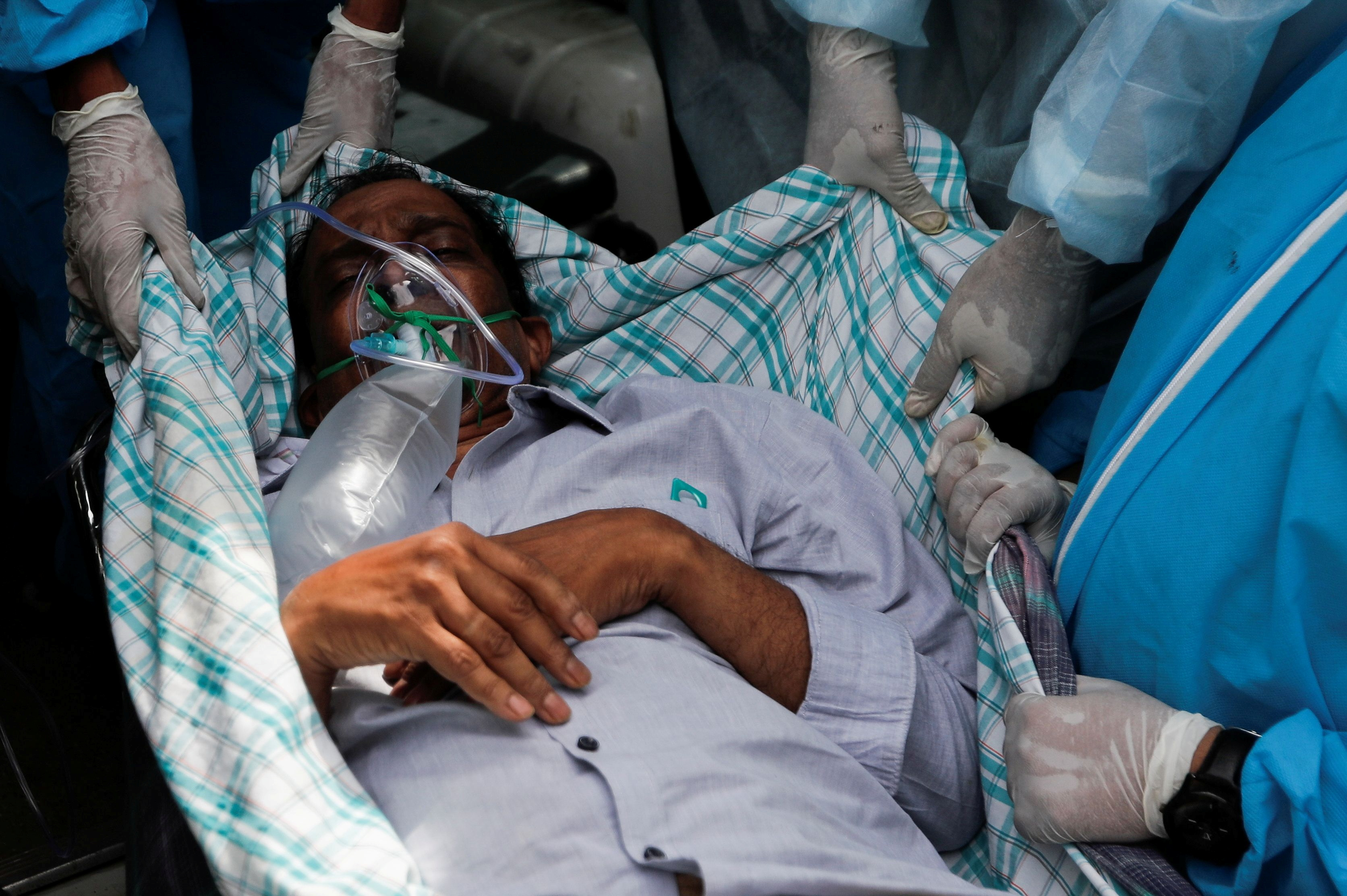 Hospitals overrun as India's COVID-19 infections top global record for  second day | Reuters