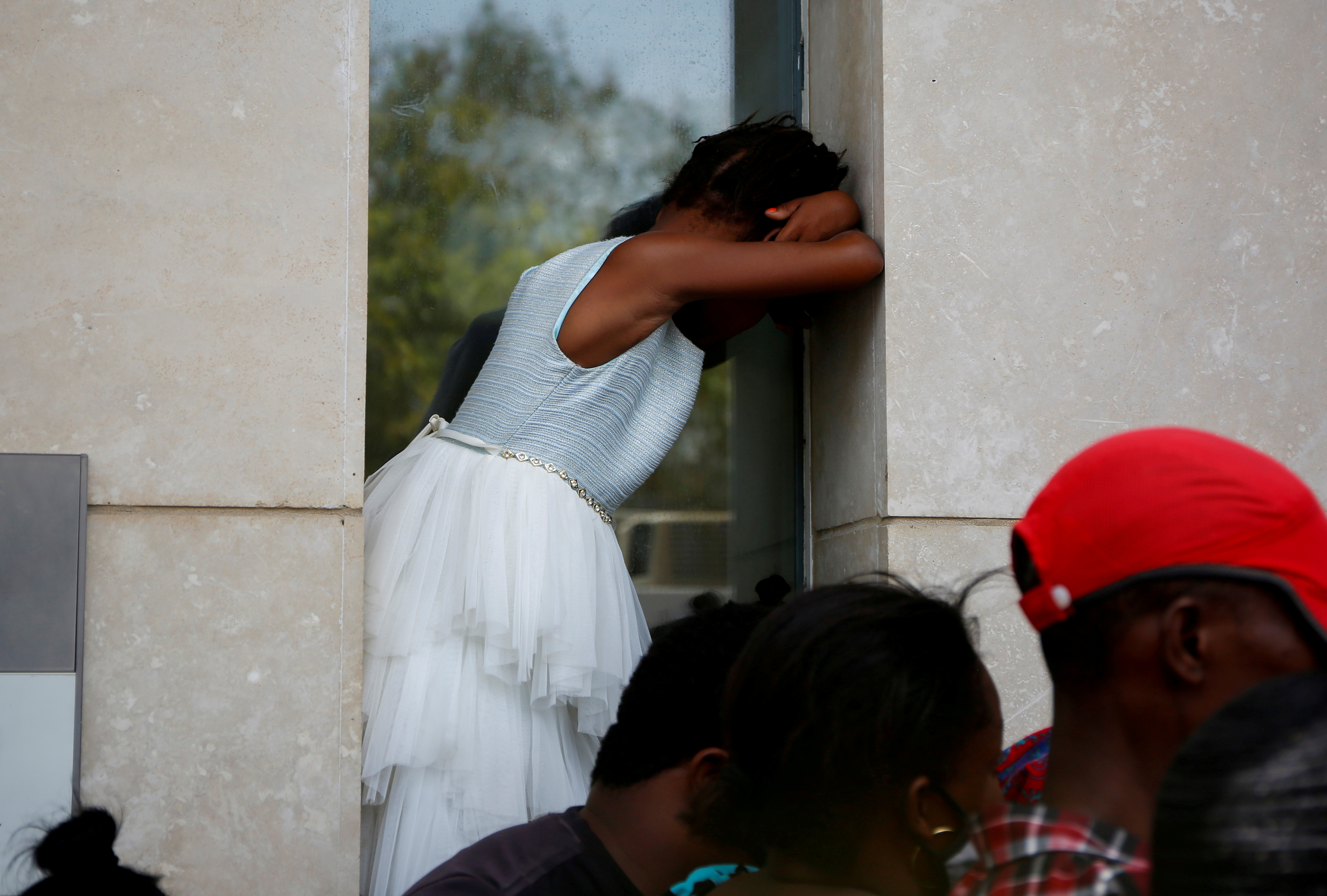 Haitians gather outside the U.S. Embassy after the assassination of President Jovenel Moise, in Port-au-Prince, Haiti July 9, 2021. REUTERS/Estailove St-Val/File Photo