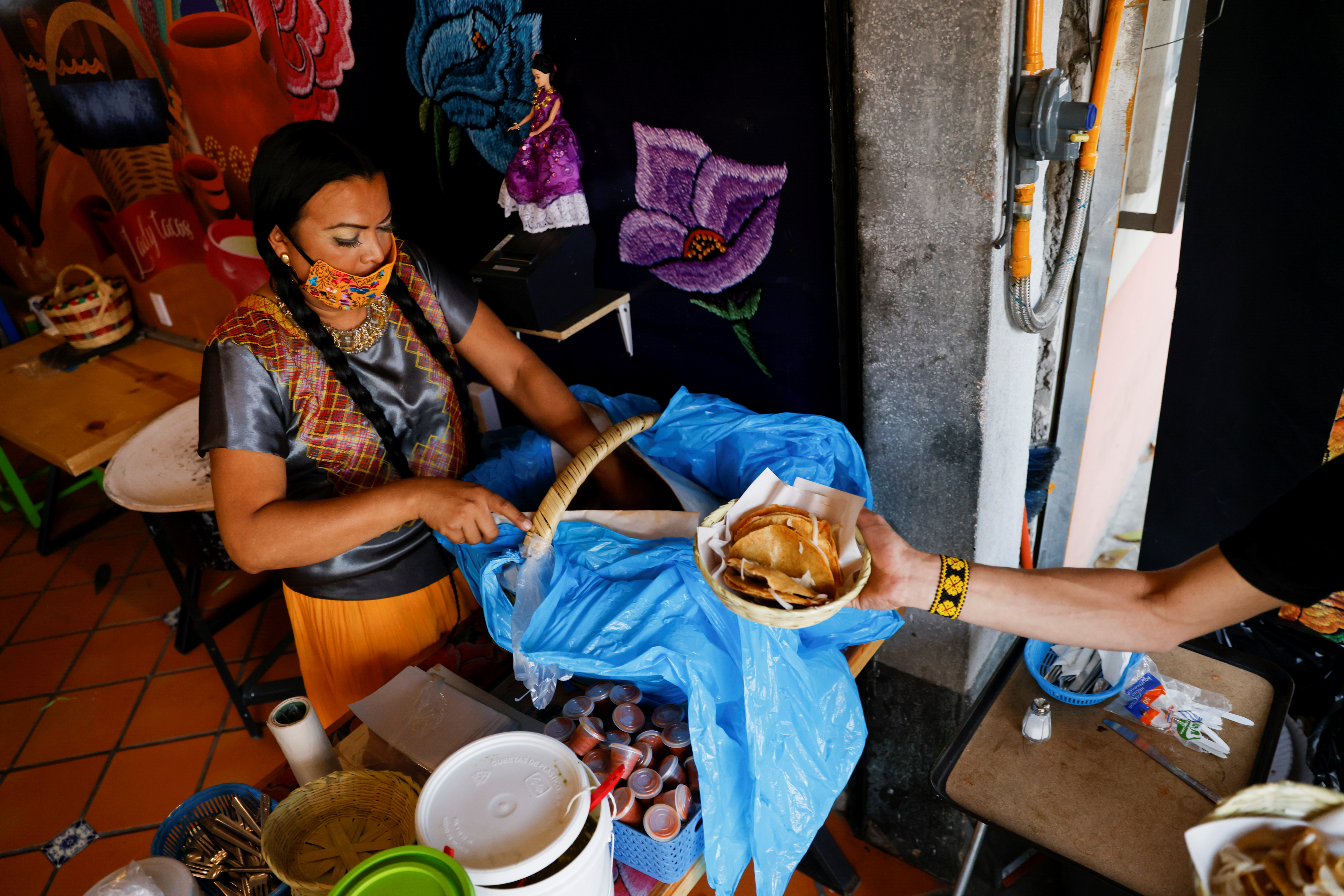 Francisco Marven, an indigenous transgender woman known as Lady Tacos de Canasta who starred in the Netflix series Taco Chronicles serves tacos at her restaurant, as she is set to campaign as a lawmaker in the local elections in June mid-terms in Mexico City, Mexico April 9, 2021. Picture taken April 9, 2021.REUTERS/Carlos Jasso
