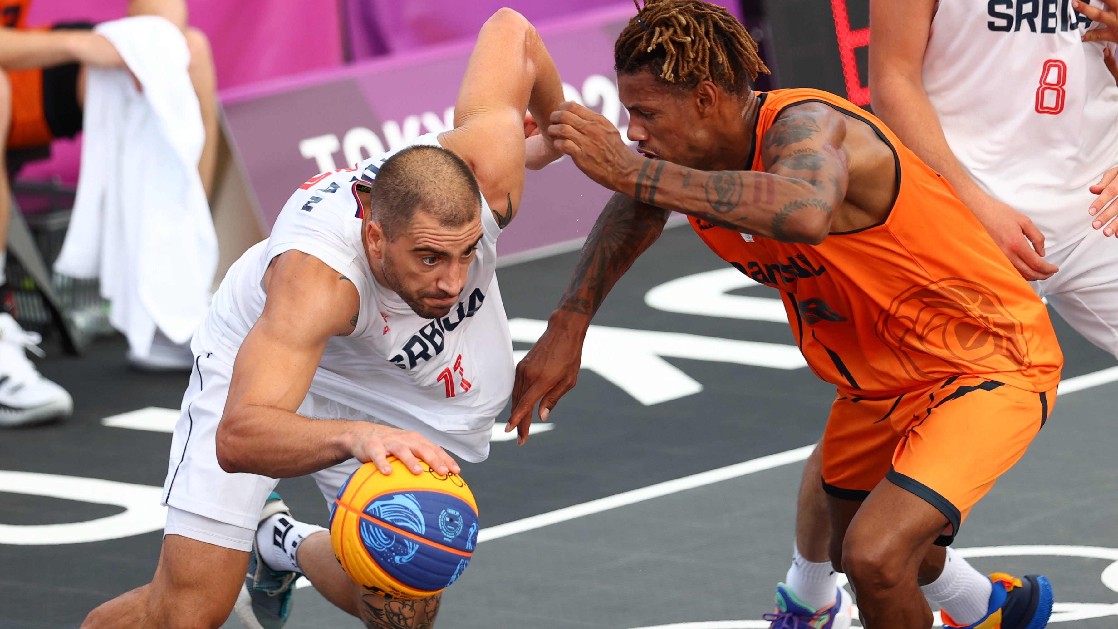 Tokyo 2020 Olympics - Basketball 3x3 - Men - Pool A - Serbia v Netherlands - Aomi Urban Sports Park, Tokyo, Japan - July 24, 2021.  Mihailo Vasic of Serbia in action with Jessey Voorn of the Netherlands during a match. REUTERS/Andrew Boyers
