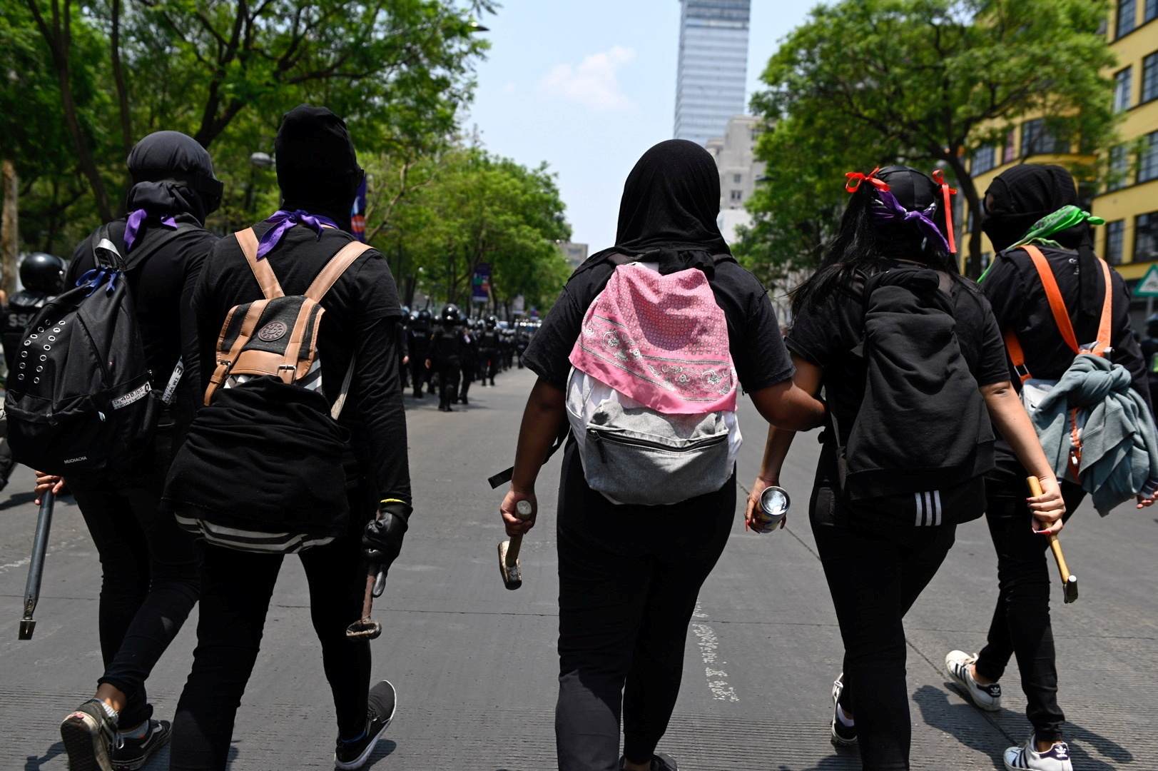 Demonstrators take to the streets during a protest of feminist collectives against the police and the excess of public force used to disperse peaceful protests, in downtown Mexico City, Mexico, May 29, 2021. REUTERS/Mahe Elipe/File Photo
