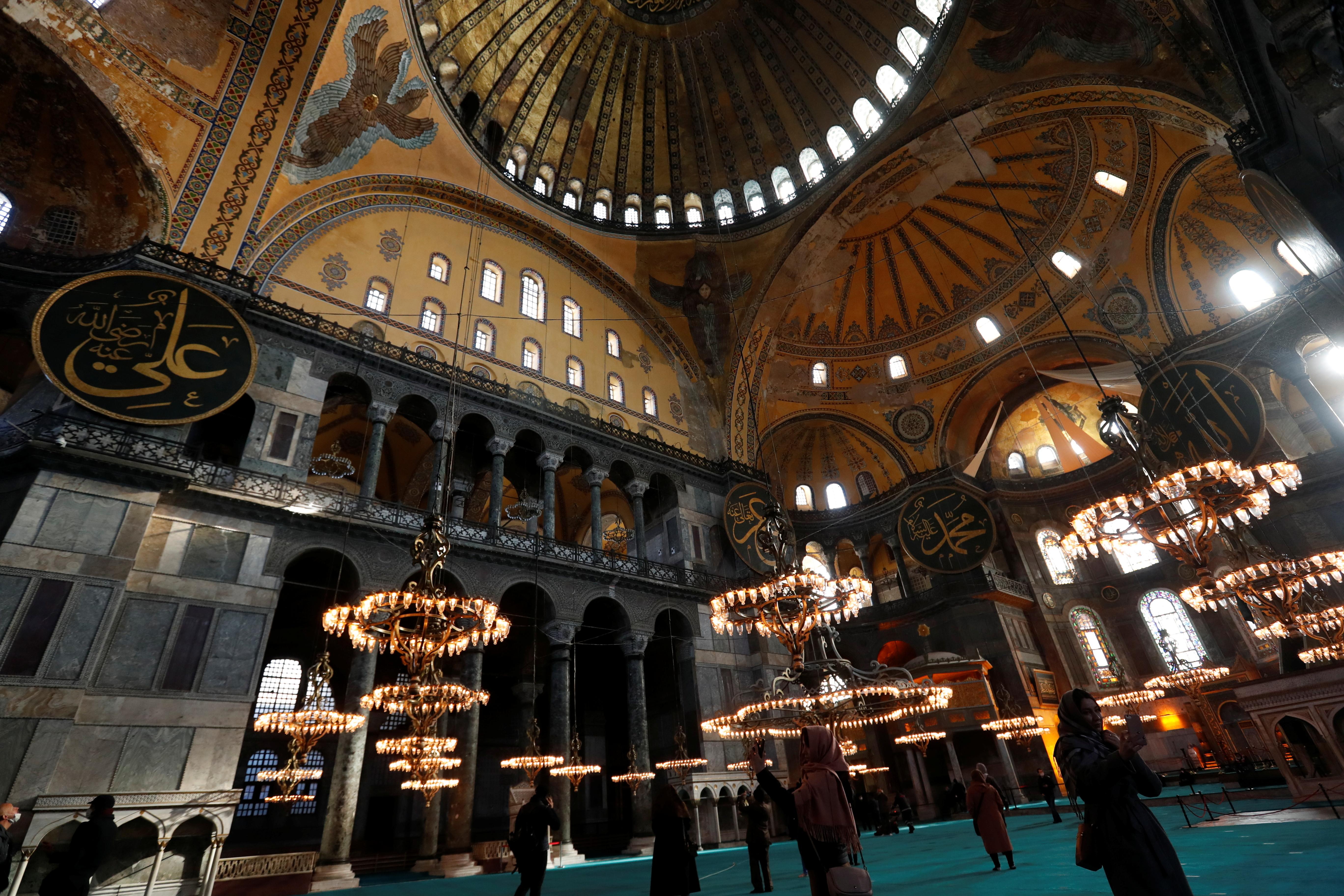 Local and foreign tourists visit Ayasofya-i Kebir Camii or Hagia Sophia Grand Mosque amid the coronavirus disease (COVID-19) outbreak in Istanbul, Turkey January 29, 2021. REUTERS/Murad Sezer