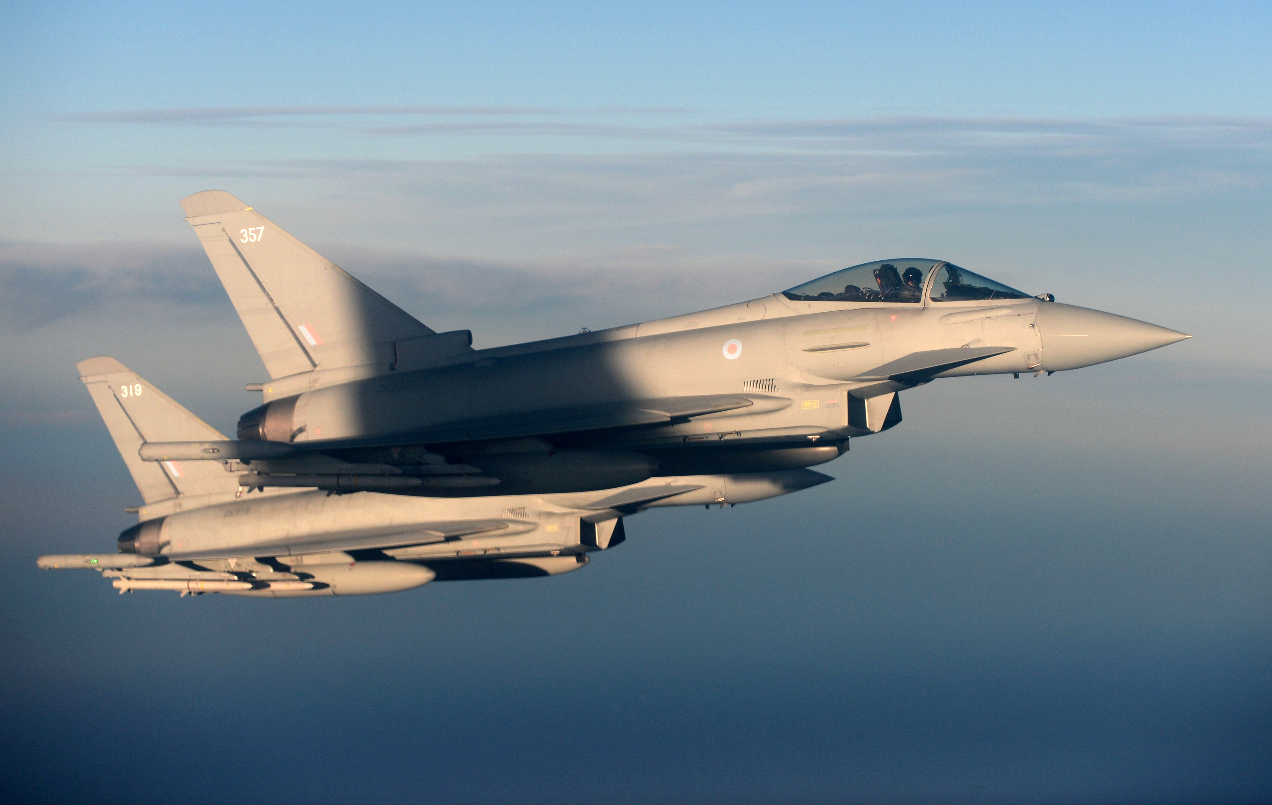 British Royal Air Force's Typhoon Eurofighter jets demonstrate the interception of a Belgian air force transport plane as they fly over Britain, January 14, 2020. Picture taken January 14, 2020. REUTERS/Johanna Geron/File Photo