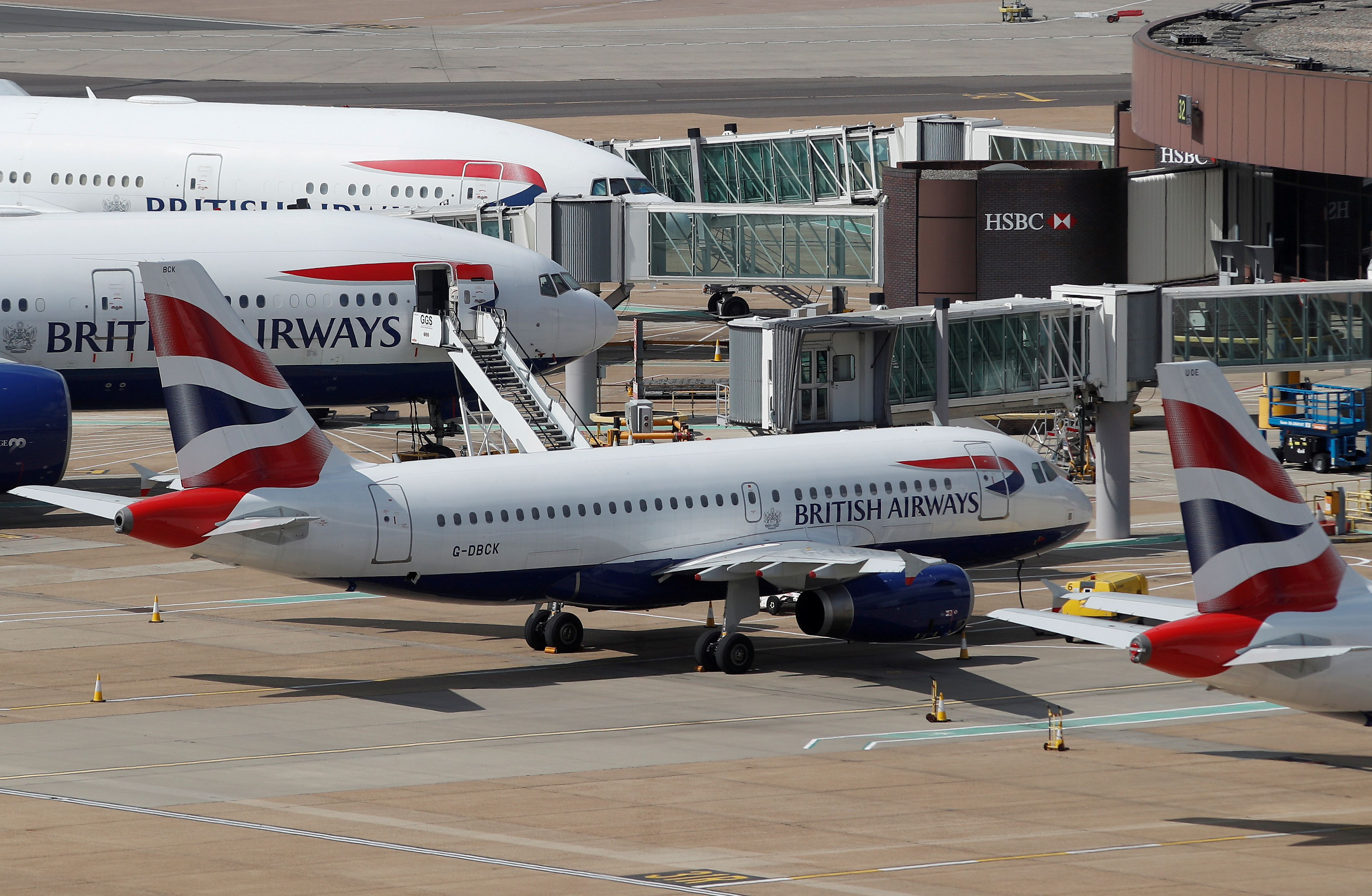 British Airways aircraft are parked at the South Terminal at Gatwick Airport, in Crawley, Britain, August 25, 2021.  REUTERS/Peter Nicholls/File Photo